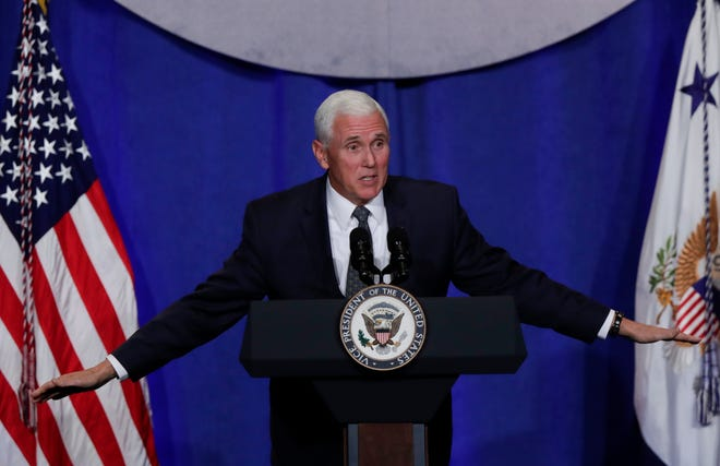 Vice President Mike Pence speaks at the Indiana Republican Party Fall Dinner in Indianapolis, Friday, Oct. 12, 2018. (AP Photo/Michael Conroy)