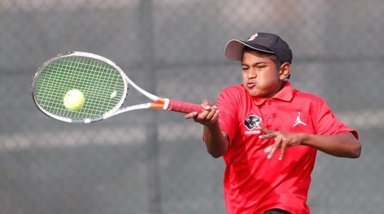 North Central High School's Ajay Mahenthiran takes on Carmel High School's Broc Fletcher during the 52nd Annual IHSAA Boys Team Tennis State Finals, held at North Central High School in Indianapolis on Saturday, October 13, 2018.