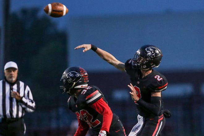North Central Panthers quarterback Liam Thompson (2) makes a touchdown pass to North Central Panthers Jordan Bingham (6) in the first half of the game at North Central High School in Indianapolis, Oct. 12, 2018.