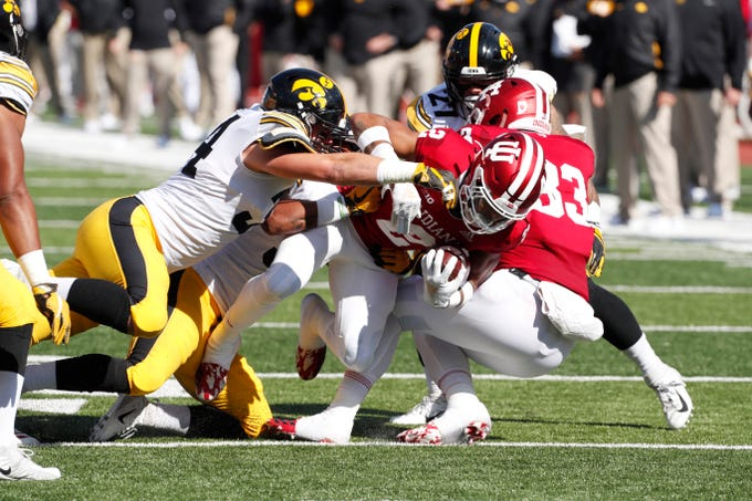 Indiana Hoosiers running back Reese Taylor (2) is tackled by Iowa Hawkeyes linebacker Kristian Welch (34) during the first quarter at Memorial Stadium .