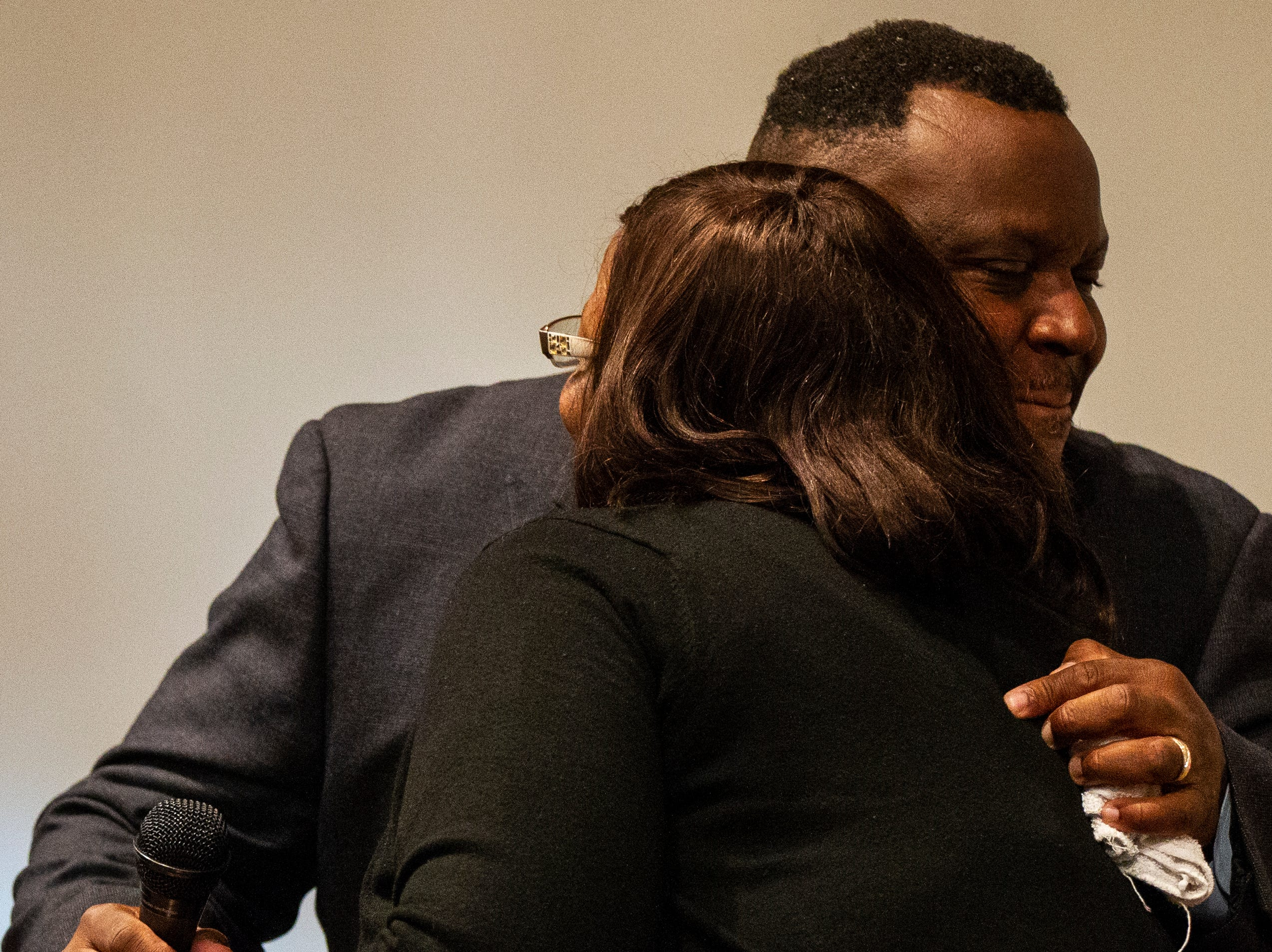 """Bruce Teague embraces his cousin Wytedgurie """"Terri"""" Murry during a swearing in ceremony for Iowa City councilor Bruce Teague on Saturday, Oct. 13, 2018, at the Church of Nazarene on Wade Street in Iowa City."""