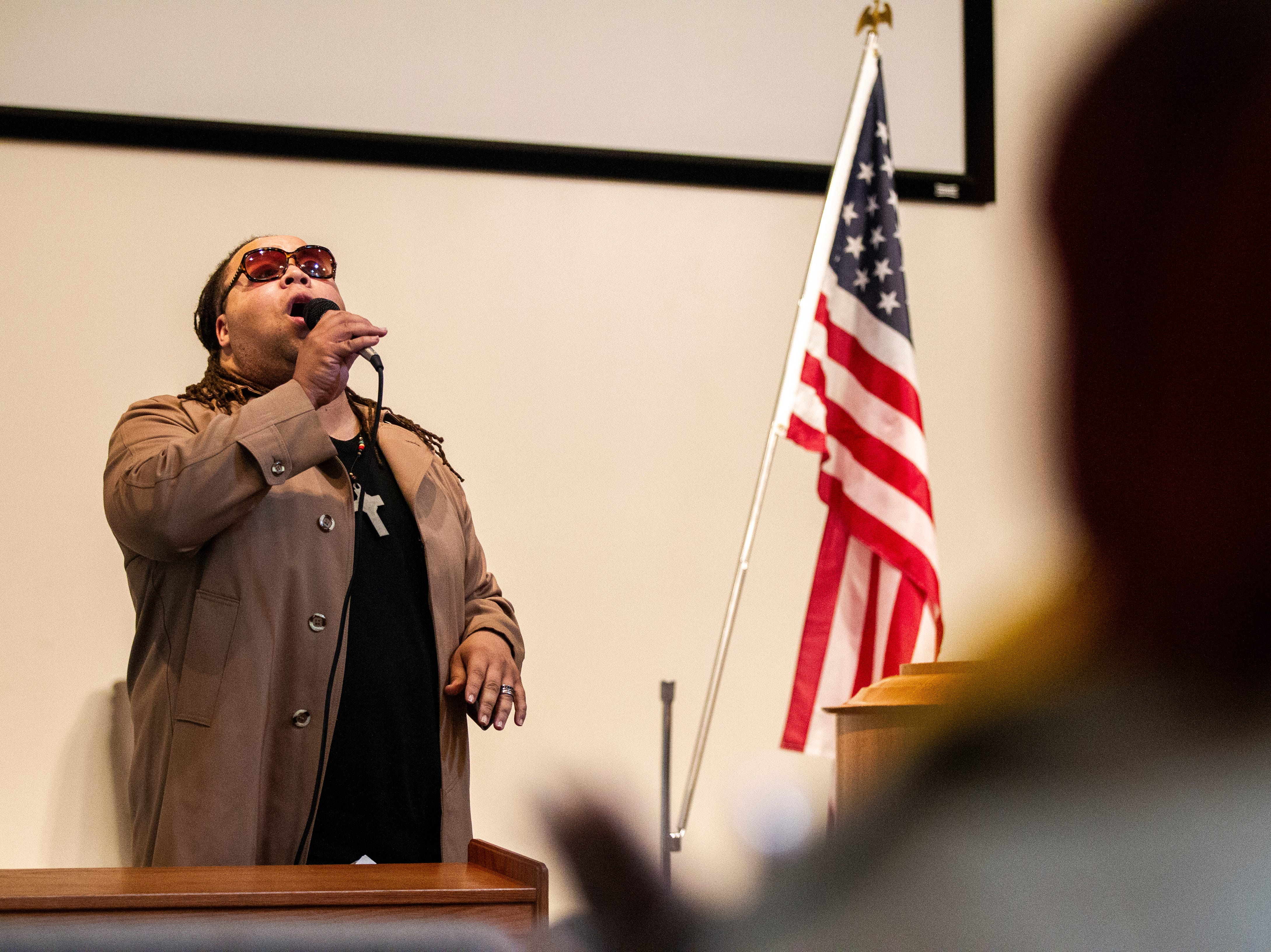 James Teague, Bruce Teague's younger brother, performs a song before a swearing in ceremony for Iowa City councilor Bruce Teague on Saturday, Oct. 13, 2018, at the Church of Nazarene on Wade Street in Iowa City.