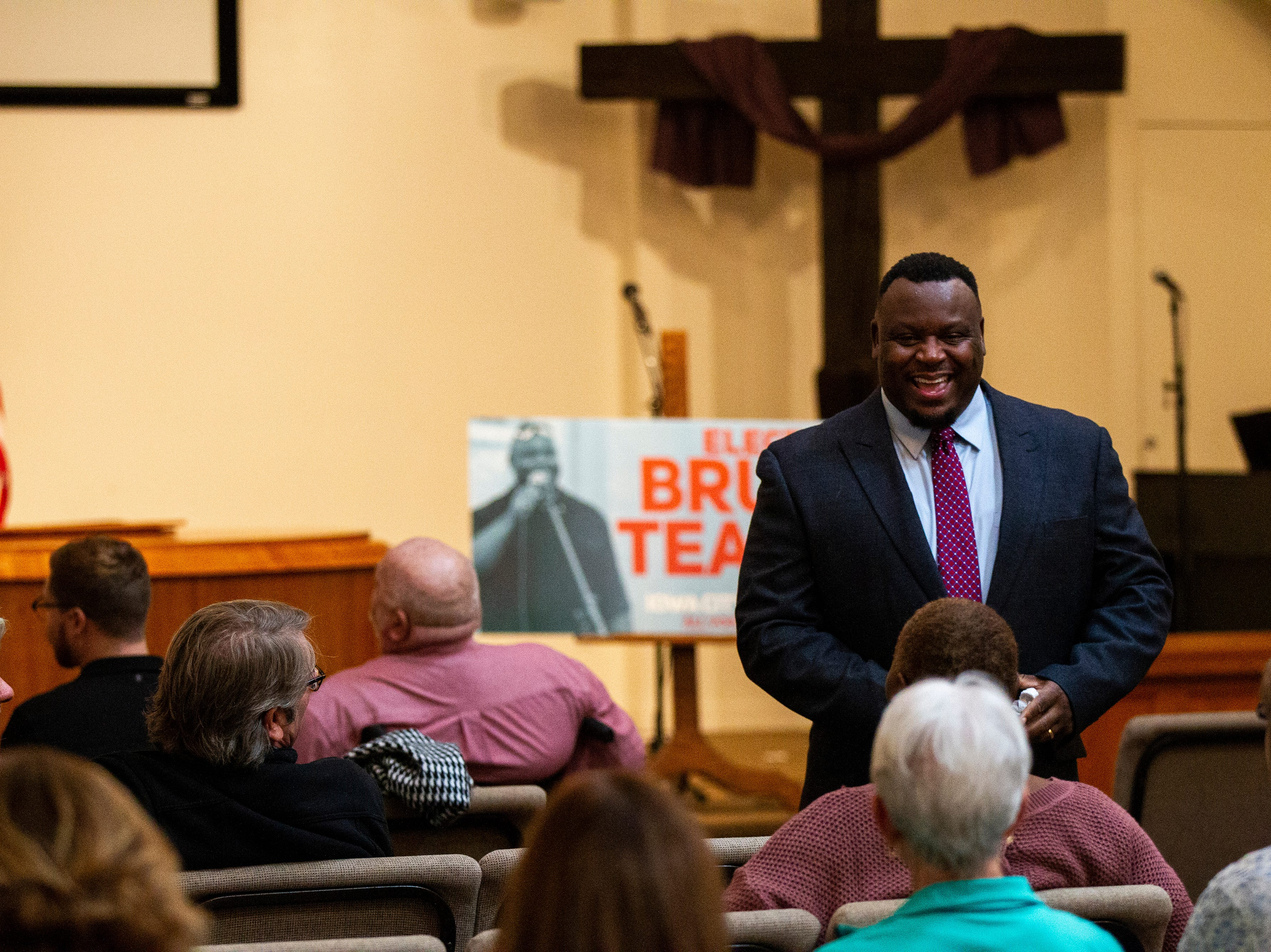 Bruce Teague greets supporters before his swearing in ceremony for Iowa City council on Saturday, Oct. 13, 2018, at the Church of Nazarene on Wade Street in Iowa City.