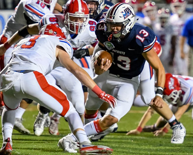 MRA running back Ridge Futral (13) looks for running room against Jackson Prep during game action held Friday  in Madison.