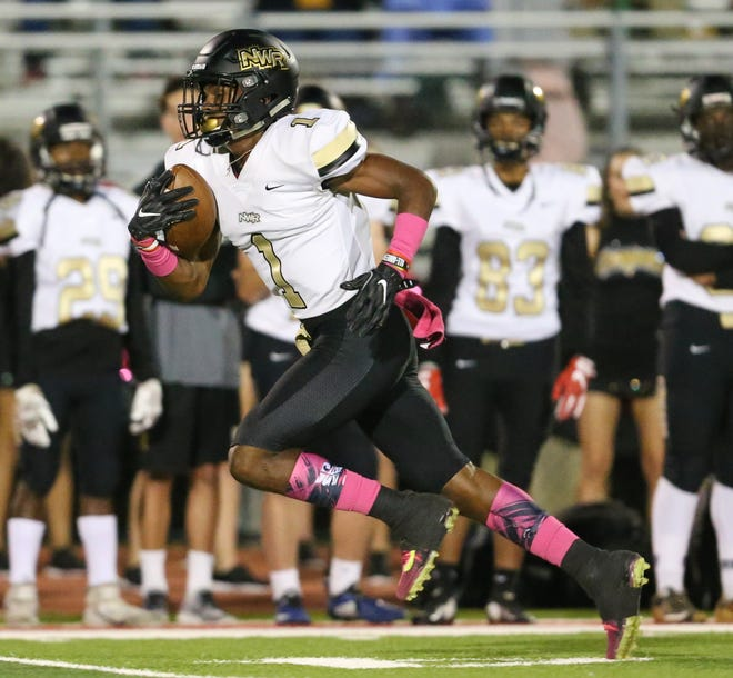 Northwest Rankin's Jarrian Jones (1) runs to the end zone for a touchdown to give Northwest Rankin the lead. Northwest Rankin played Clinton in a Class 6A football game Friday at Clinton.