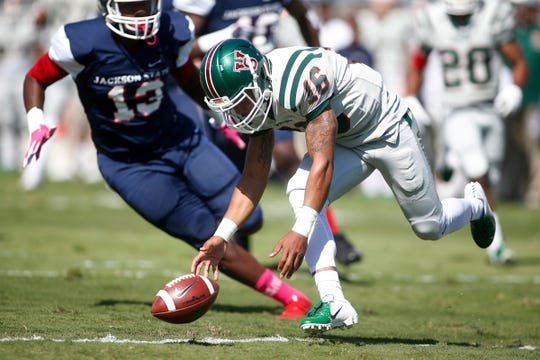 MVSU quarterback Dejerric Bryant loses control of the ball as JSU defender Khalil Johnson closes in during the first half of play.