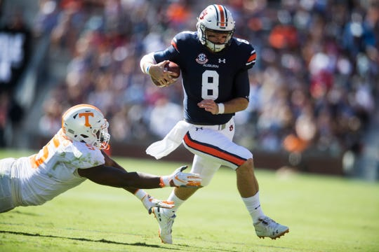 Auburn quarterback Jarrett Stidham (8) is attacked by Tennessee defensive lineman Kyle Phillips (5) during a game between Tennessee and Auburn at Jordan-Hare Stadium in Auburn, Alabama on Saturday, October 13, 2018.