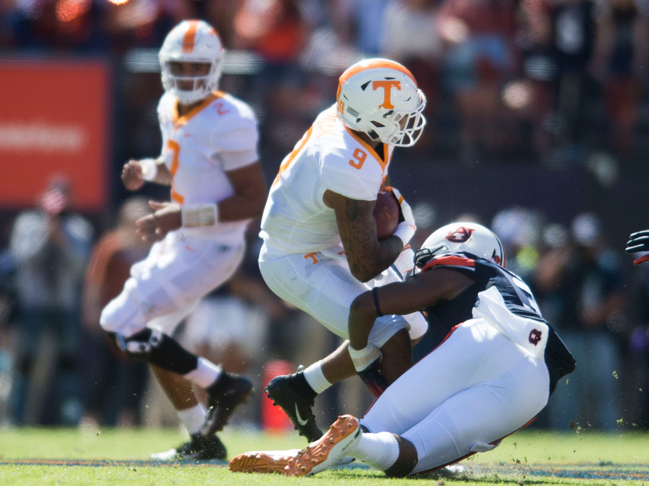 Tennessee running back Tim Jordan (9) is tackled by Auburn defensive lineman Marlon Davidson (3) during a game between Tennessee and Auburn at Jordan-Hare Stadium in Auburn, Ala. Saturday, Oct. 13, 2018.