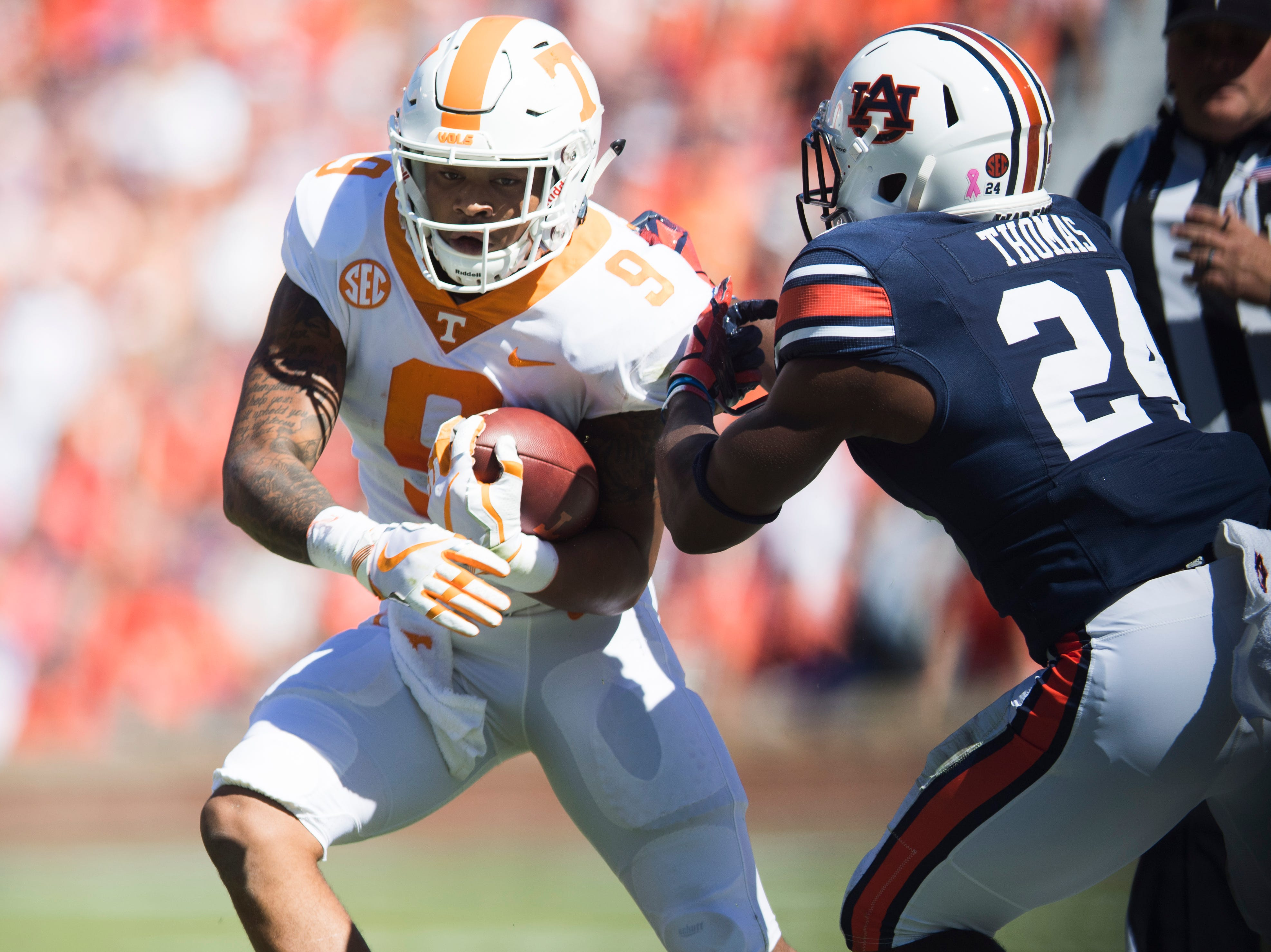 Auburn defensive back Daniel Thomas (24) tackles Tennessee running back Tim Jordan (9) during a game between Tennessee and Auburn at Jordan-Hare Stadium in Auburn, Alabama on Saturday, October 13, 2018.
