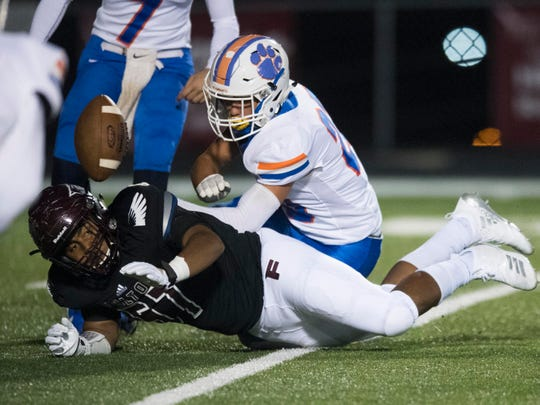 Campbell County's CJ Allen (23) and Fulton's Deairus Farmer (57) chase after a loose ball on Friday, October 12, 2018. The fumble was recovered by Campbell County.