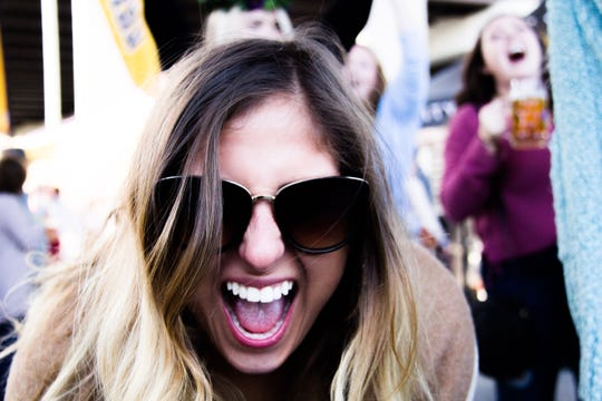 While attending the inaugural Old City Oktoberfest, Louise Langevin reacts to an announcement that UT defeated Auburn in a football game Saturday.