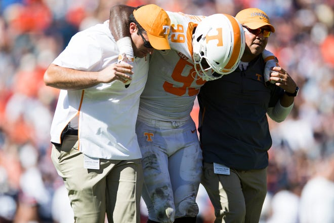 Tennessee linebacker Jonathan Kongbo (99) is helped off the field after being injured Saturday against Auburn.