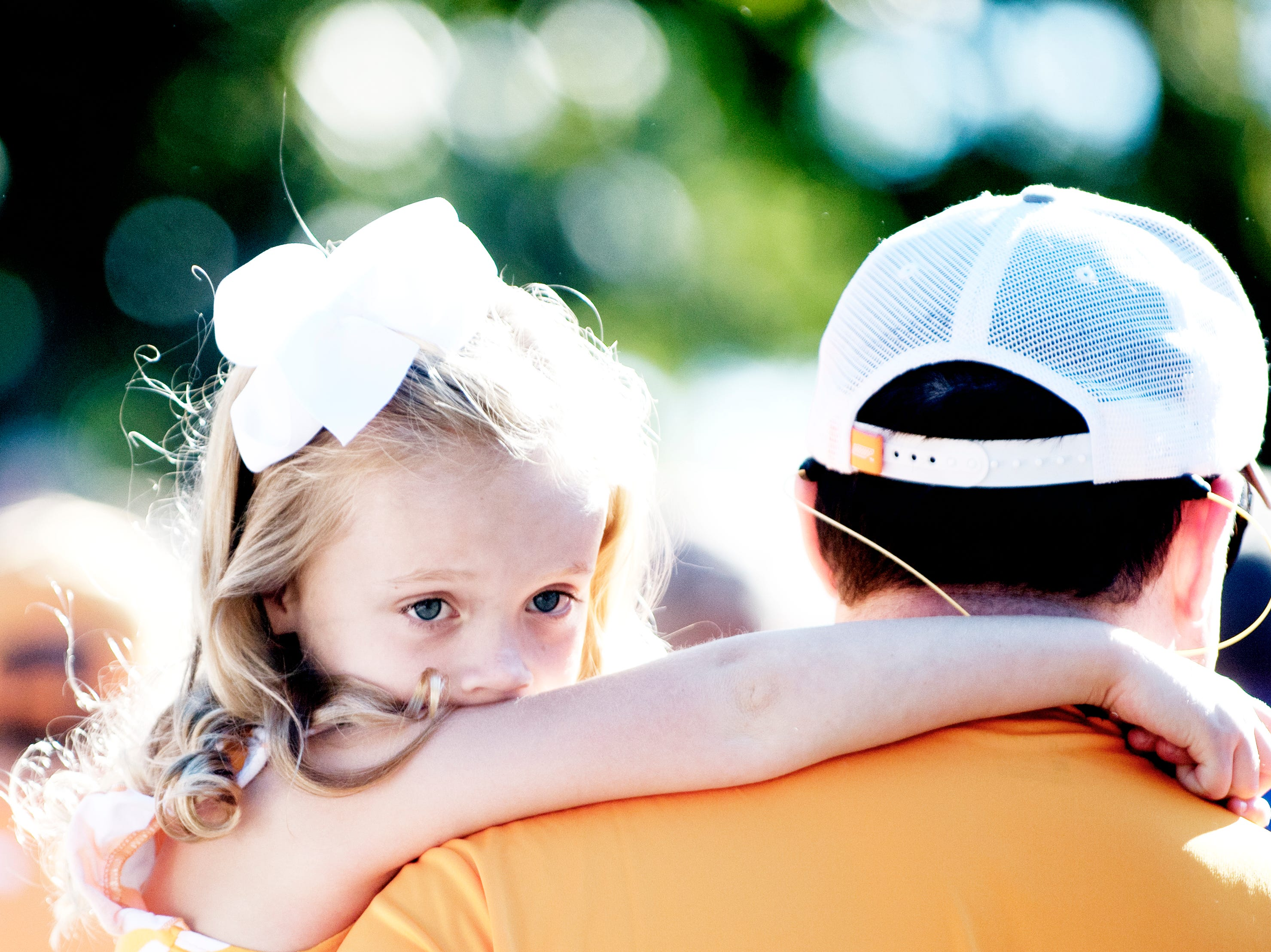 A young Vol fan rests on the shoulders of her father during a game between Tennessee and Auburn at Jordan-Hare Stadium in Auburn, Alabama on Saturday, October 13, 2018.