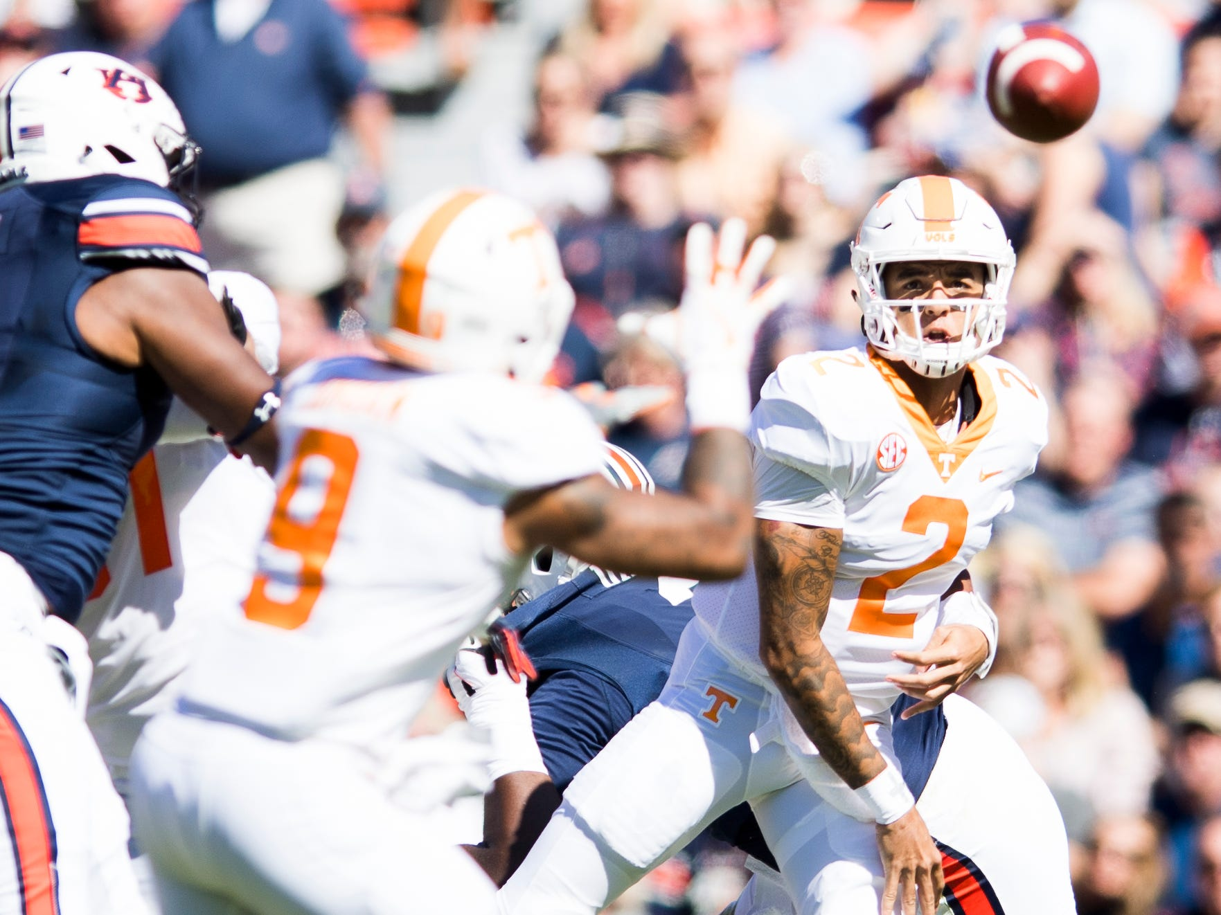 Tennessee quarterback Jarrett Guarantano (2) throws a pass to Tennessee running back Tim Jordan (9) during a game between Tennessee and Auburn at Jordan-Hare Stadium in Auburn, Alabama on Saturday, October 13, 2018.