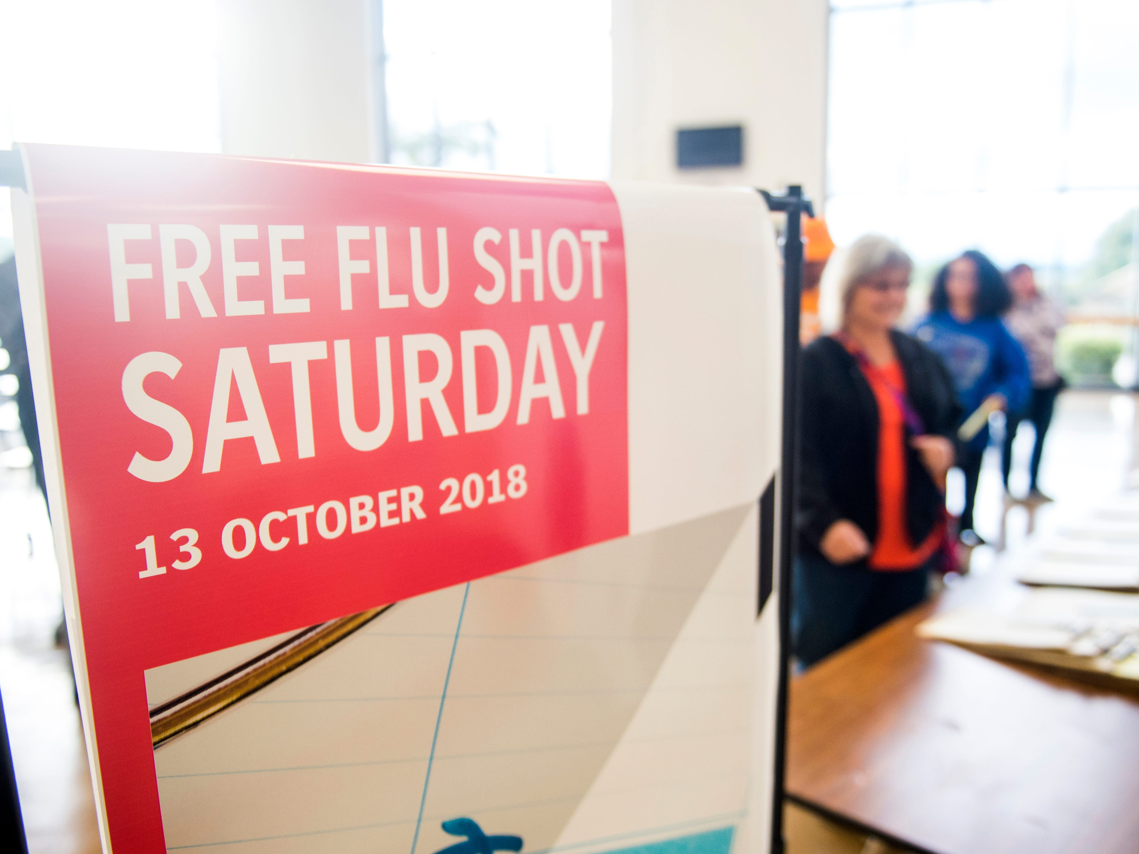 People stream into Farragut High School for a free flu shot during Free Flu Shot Saturday on Saturday, October 12, 2018.