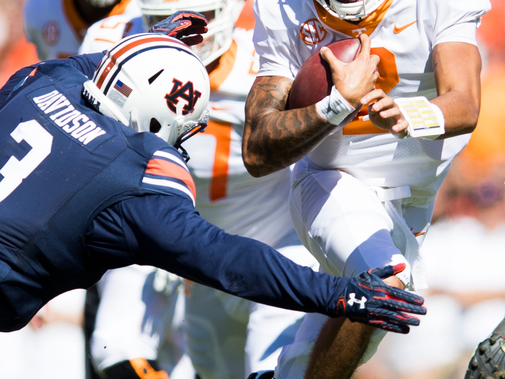 Tennessee quarterback Jarrett Guarantano (2) runs with the ball as Auburn defensive lineman Marlon Davidson (3) defends during a game between Tennessee and Auburn at Jordan-Hare Stadium in Auburn, Alabama on Saturday, October 13, 2018.