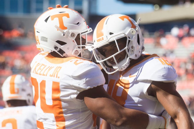 Tennessee defensive back Todd Kelly Jr. (24)  and Tennessee defensive back Nigel Warrior (18) embrace before a game between Tennessee and Auburn at Jordan-Hare Stadium in Auburn, Ala. Saturday, Oct. 13, 2018.