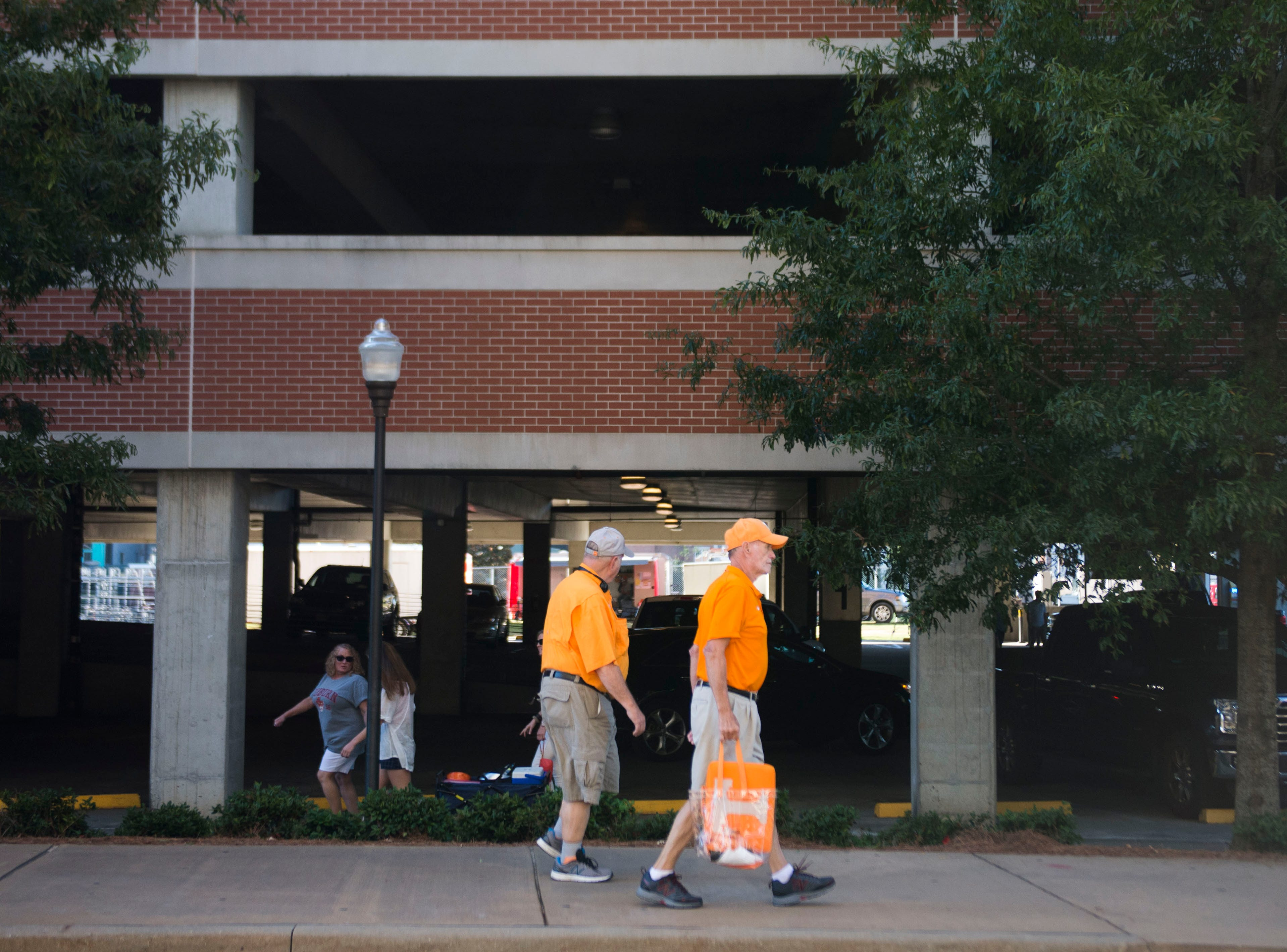 Vols fans walk around Auburn's campus before a game between Tennessee and Auburn at Jordan-Hare Stadium in Auburn, Ala. Saturday, Oct. 13, 2018.