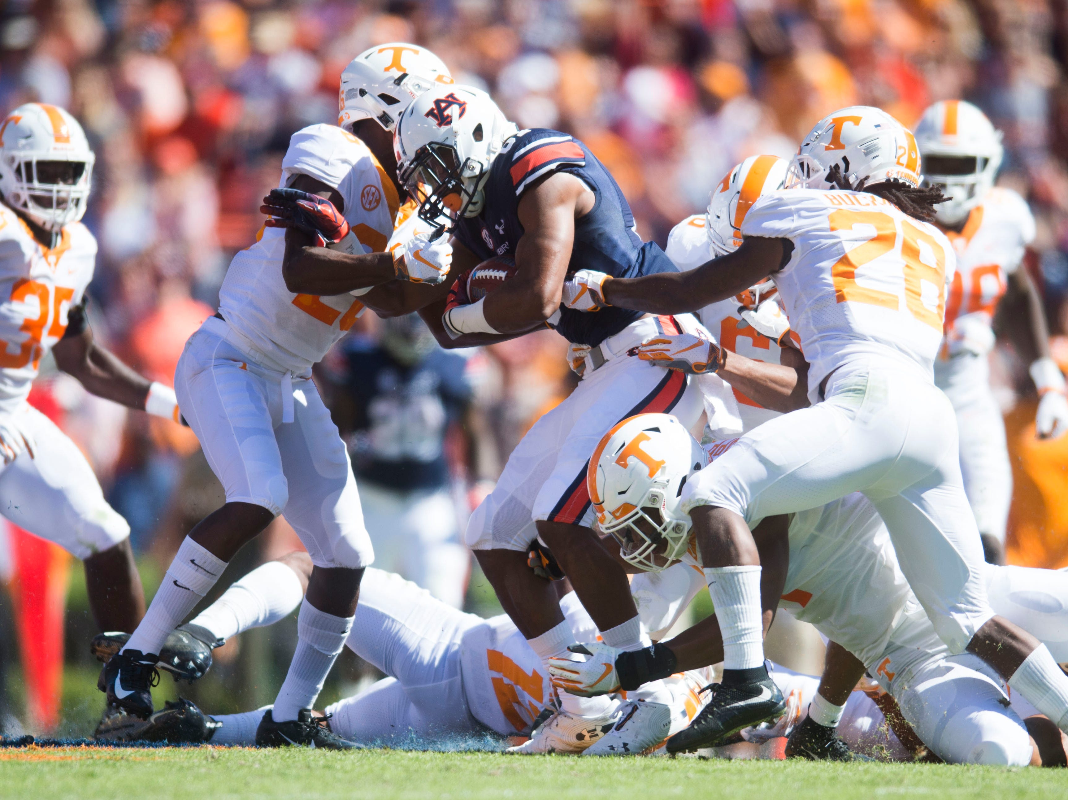 Auburn wide receiver Darius Slayton (81) is taken down by Tennessee players during a game between Tennessee and Auburn at Jordan-Hare Stadium in Auburn, Ala. Saturday, Oct. 13, 2018.
