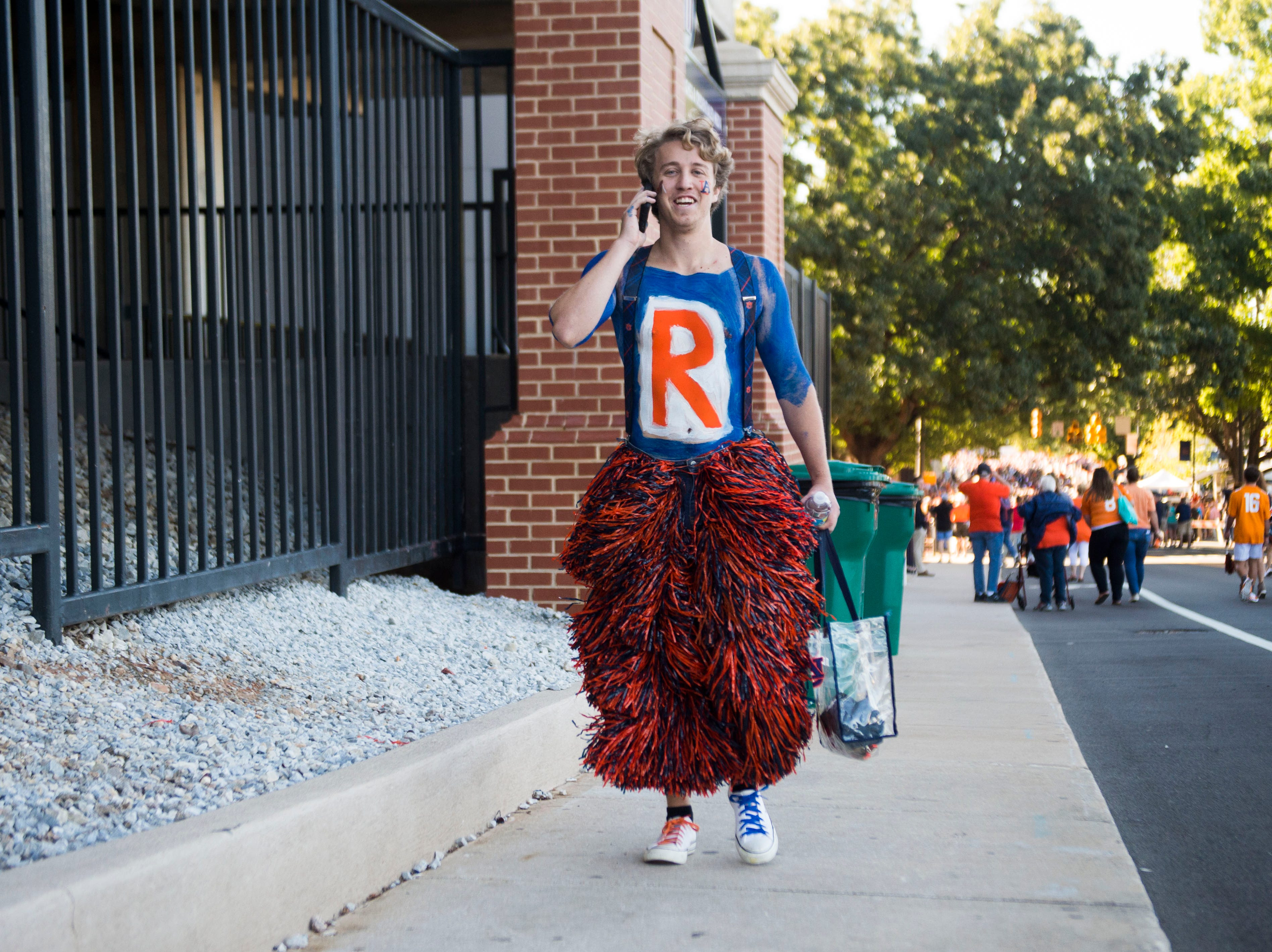 A festive Auburn fan walks outside the stadium before a game between Tennessee and Auburn at Jordan-Hare Stadium in Auburn, Ala. Saturday, Oct. 13, 2018.