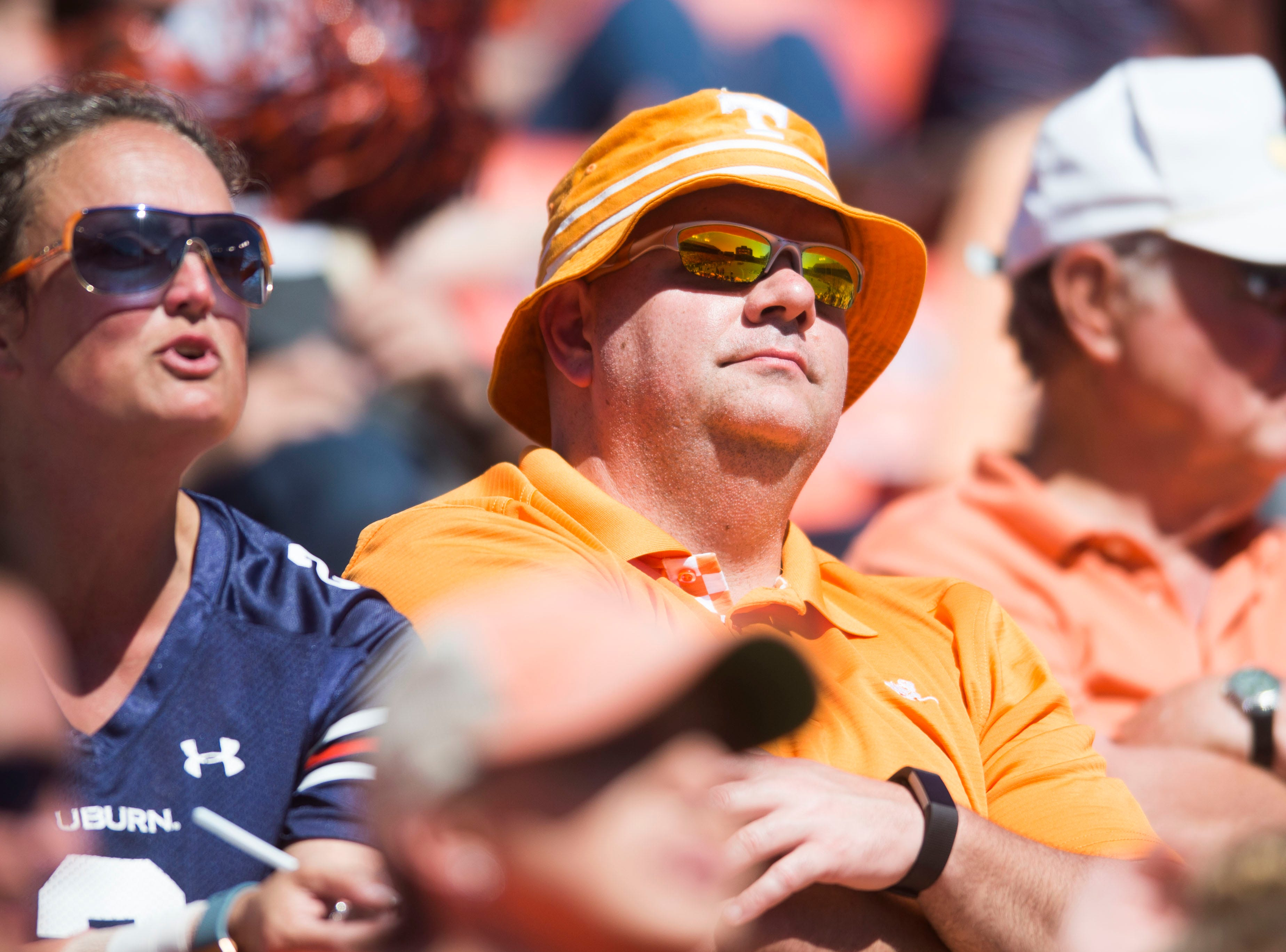A fan watches during a game between Tennessee and Auburn at Jordan-Hare Stadium in Auburn, Ala. Saturday, Oct. 13, 2018. Tennessee defeated Auburn 30-24.