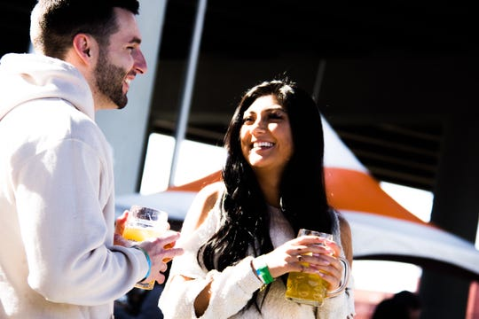 Brad Martin and Kaylee Geiler talk over a beer at the inaugural Old City Oktoberfest on Saturday.