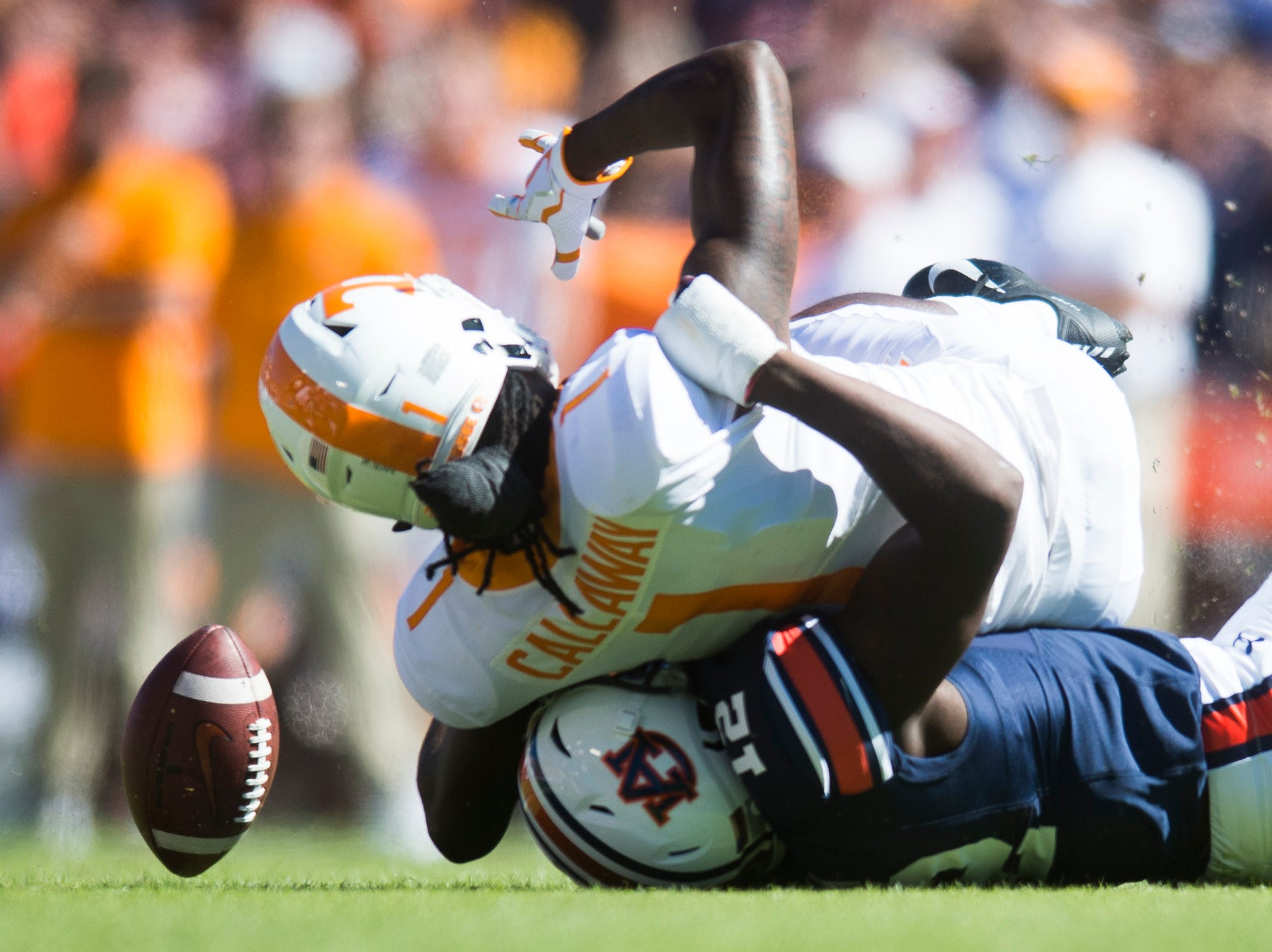 Tennessee wide receiver Marquez Callaway (1)  is taken down by Auburn defensive back Jamel Dean (12) during a game between Tennessee and Auburn at Jordan-Hare Stadium in Auburn, Alabama on Saturday, October 13, 2018.