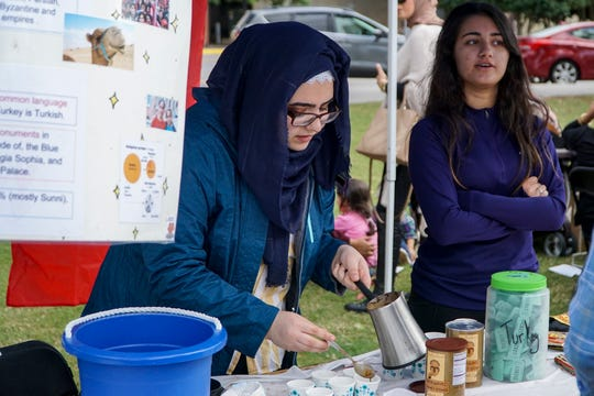 Seline Sazil spoons out servings of Turkish coffee at the 17th annual International Food Festival benefiting Annoor Academy on Saturday.