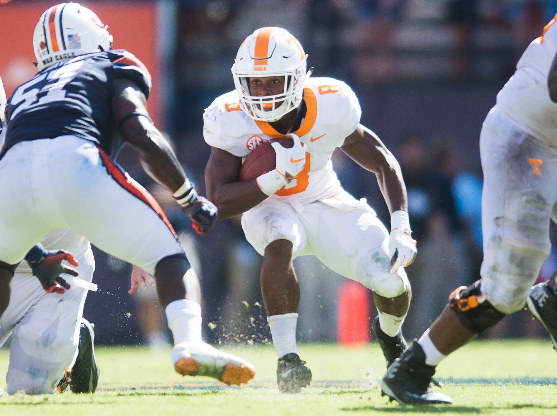 Tennessee running back Ty Chandler (8) runs the ball during a game between Tennessee and Auburn at Jordan-Hare Stadium in Auburn, Ala. Saturday, Oct. 13, 2018. Tennessee defeated Auburn 30-24.