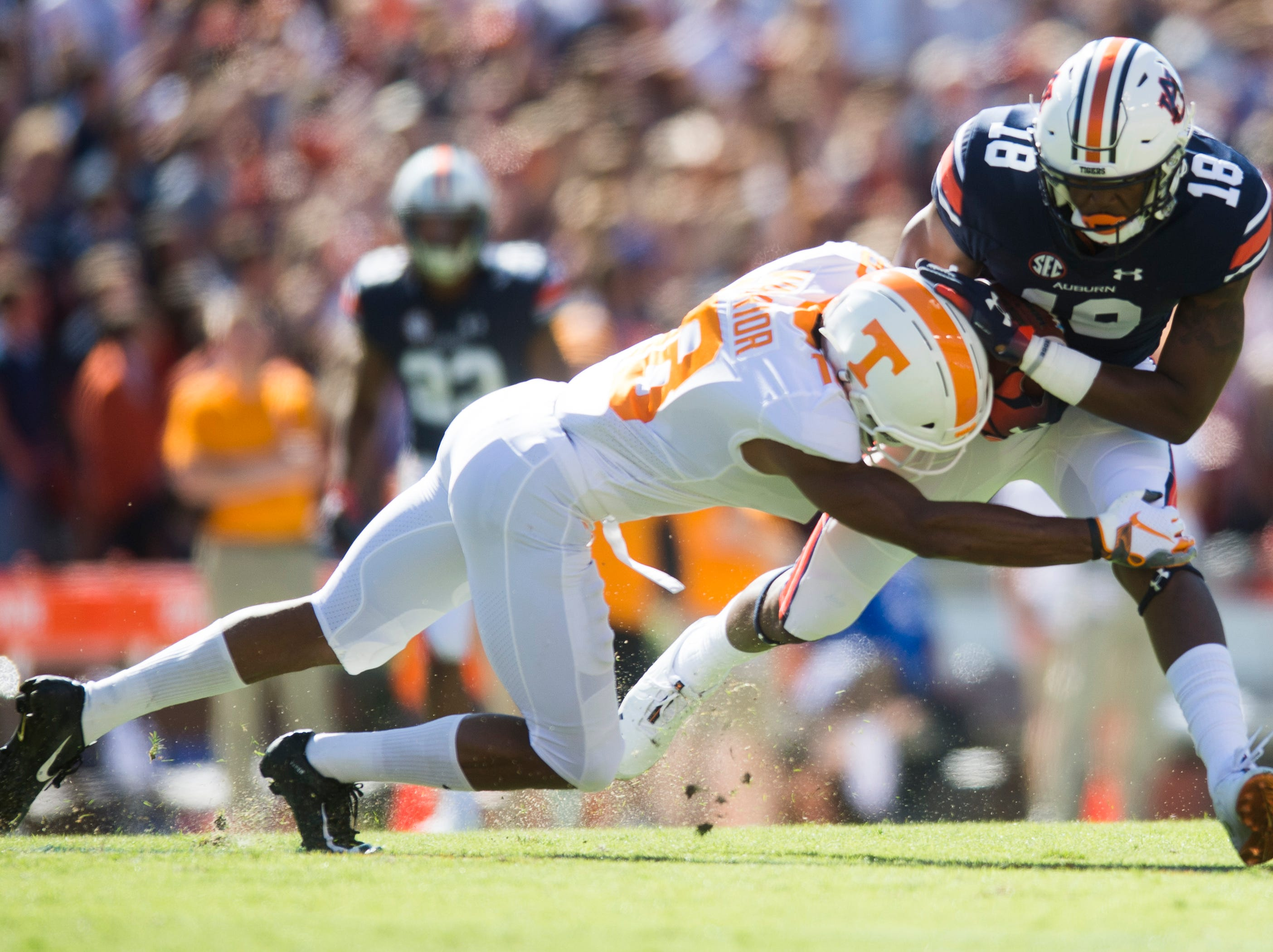 Tennessee defensive back Nigel Warrior (18) tackles Auburn wide receiver Seth Williams (18) during a game between Tennessee and Auburn at Jordan-Hare Stadium in Auburn, Alabama on Saturday, October 13, 2018.