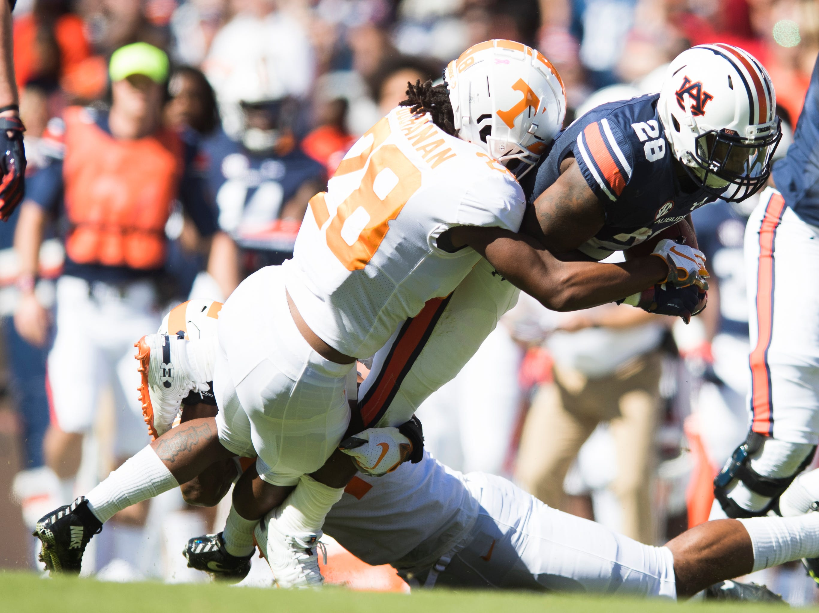Tennessee defensive back Baylen Buchanan (28)  takes down Auburn running back JaTarvious Whitlow (28) during a game between Tennessee and Auburn at Jordan-Hare Stadium in Auburn, Alabama on Saturday, October 13, 2018.