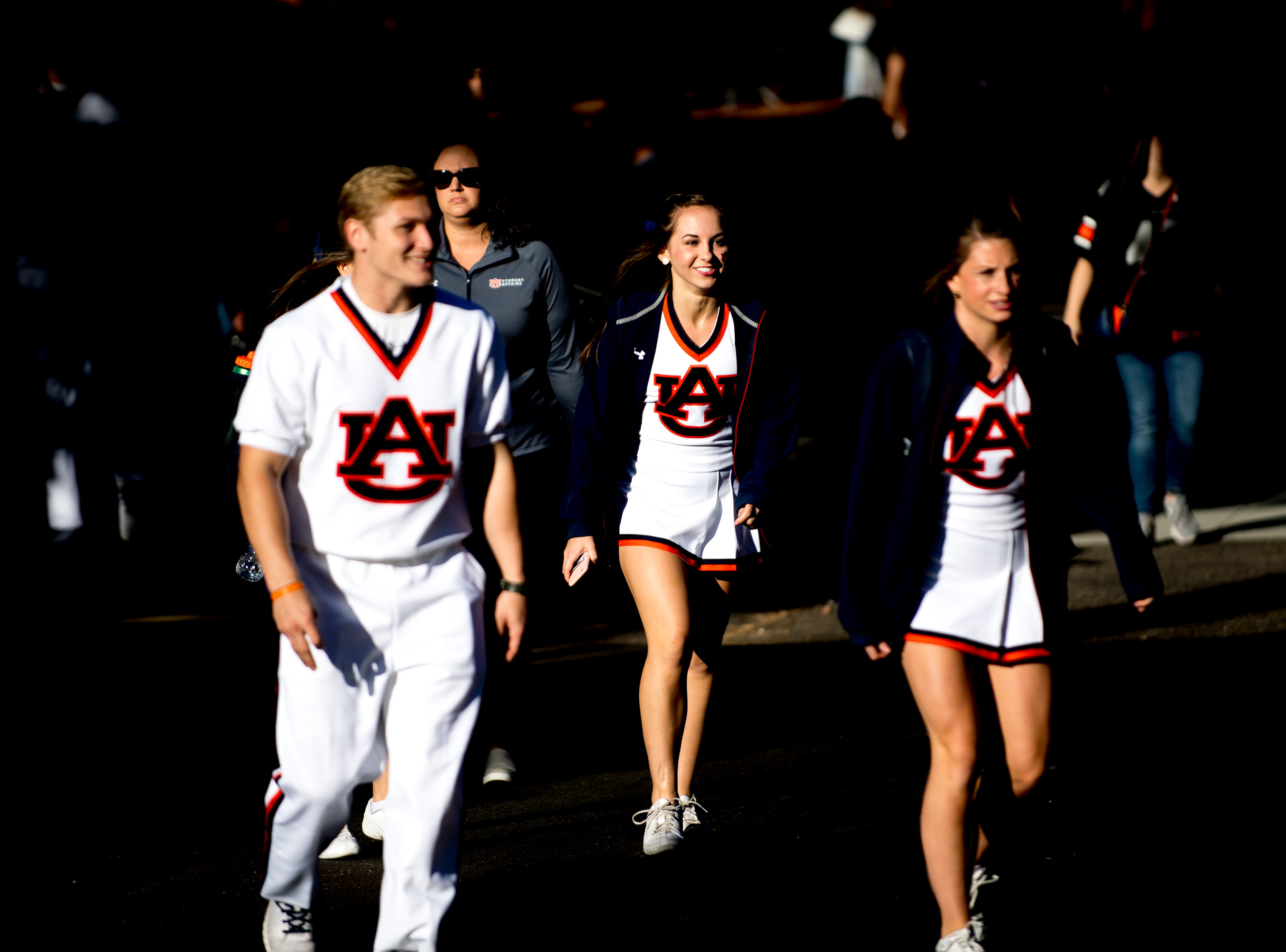 Auburn cheerleaders arrive at the stadium during a game between Tennessee and Auburn at Jordan-Hare Stadium in Auburn, Alabama on Saturday, October 13, 2018.