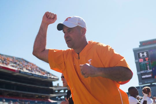 Tennessee Head Coach Jeremy Pruitt runs off the field after a game between Tennessee and Auburn at Jordan-Hare Stadium in Auburn, Ala. Saturday, Oct. 13, 2018. Tennessee defeated Auburn 30-24.
