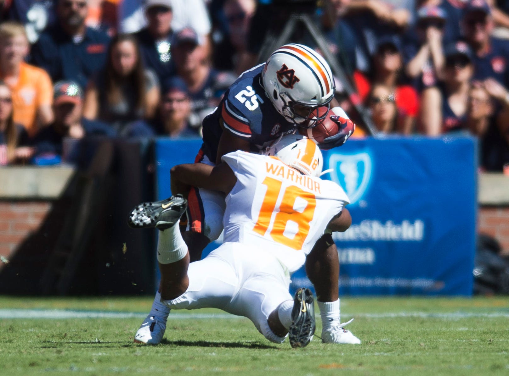 Tennessee defensive back Nigel Warrior (18) takes down Auburn running back Shaun Shivers (25) during a game between Tennessee and Auburn at Jordan-Hare Stadium in Auburn, Ala. Saturday, Oct. 13, 2018.