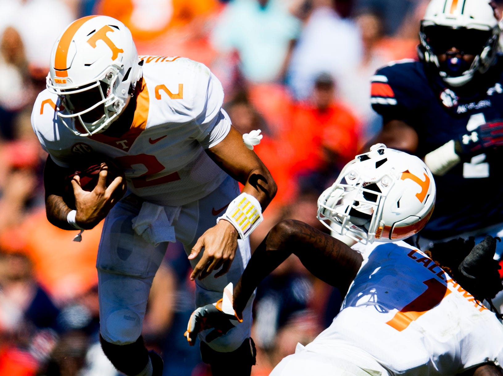 Tennessee wide receiver Marquez Callaway (1) loses his helmet as Tennessee quarterback Jarrett Guarantano (2) runs around him during a game between Tennessee and Auburn at Jordan-Hare Stadium in Auburn, Alabama on Saturday, October 13, 2018.