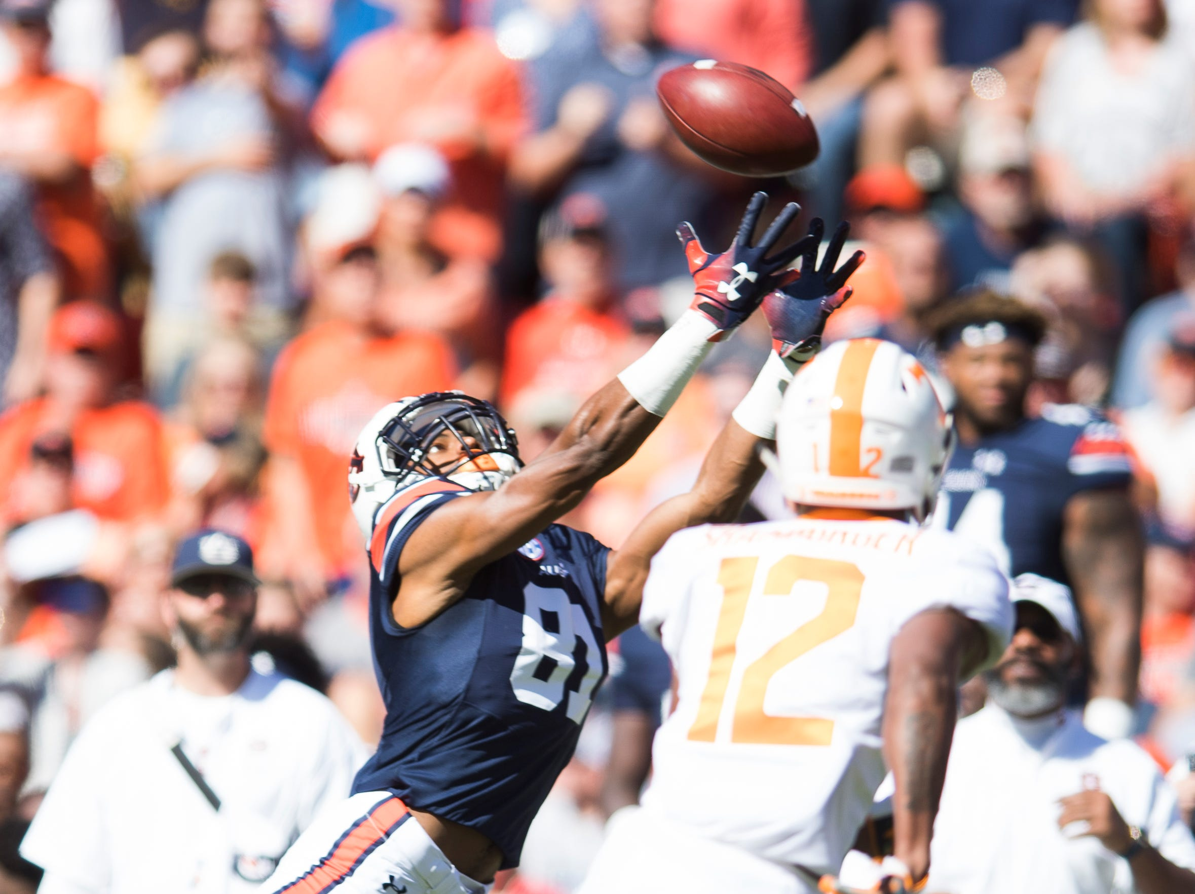 Auburn wide receiver Darius Slayton (81) reaches for a pass but is incomplete as Tennessee quarterback JT Shrout (12) defends during a game between Tennessee and Auburn at Jordan-Hare Stadium in Auburn, Alabama on Saturday, October 13, 2018.