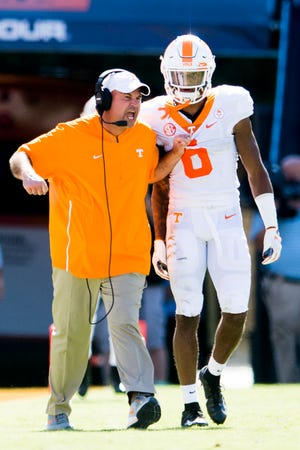 Tennessee Head Coach Jeremy Pruitt pulls Tennessee defensive back/wide receiver Alontae Taylor (6) by his jersey after a play during a game between Tennessee and Auburn at Jordan-Hare Stadium in Auburn, Alabama on Saturday, October 13, 2018.