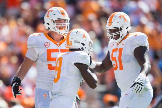 Tennessee offensive lineman Nathan Niehaus (57) and Tennessee offensive lineman Drew Richmond (51) celebrate Tennessee running back Ty Chandler's (8) touchdown during a game between Tennessee and Auburn at Jordan-Hare Stadium in Auburn, Ala. Saturday, Oct. 13, 2018.