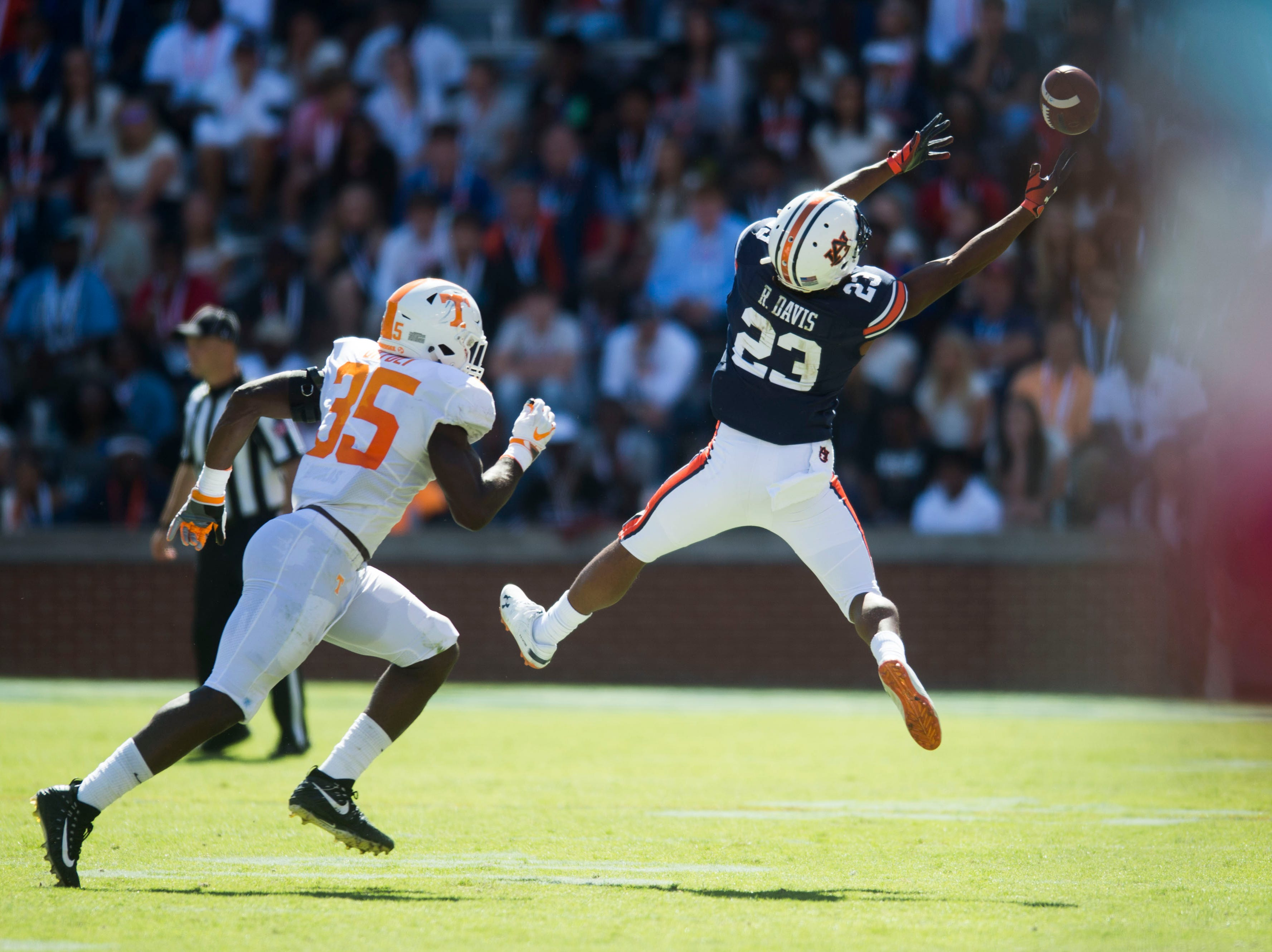 Auburn wide receiver Ryan Davis (23) misses a catch as Tennessee linebacker Daniel Bituli (35) defends him during a game between Tennessee and Auburn at Jordan-Hare Stadium in Auburn, Ala. Saturday, Oct. 13, 2018. Tennessee defeated Auburn 30-24.