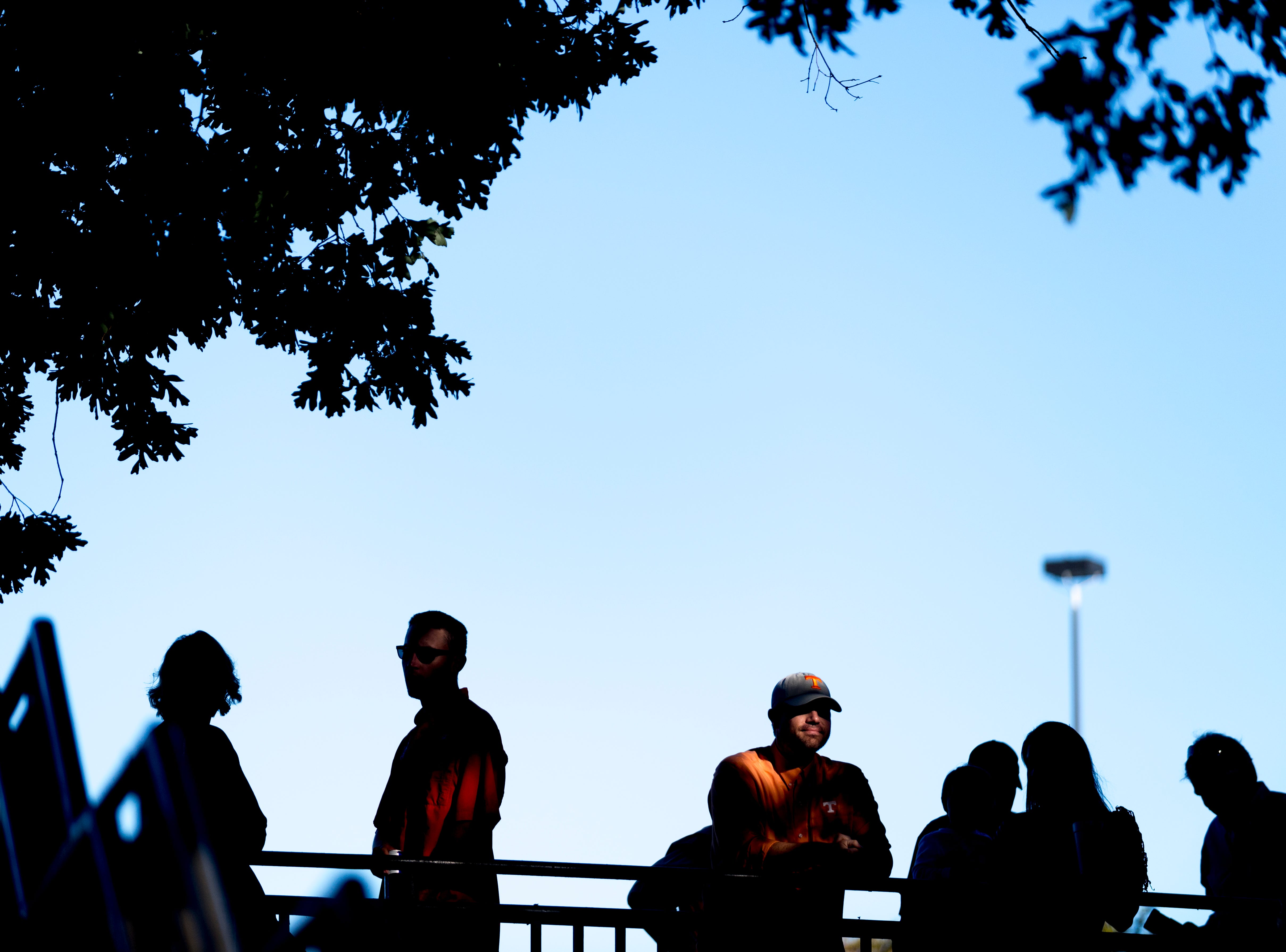 Jonathan Wood, of Tullahoma, Tennessee, stands in the shade with his family during a game between Tennessee and Auburn at Jordan-Hare Stadium in Auburn, Alabama on Saturday, October 13, 2018.
