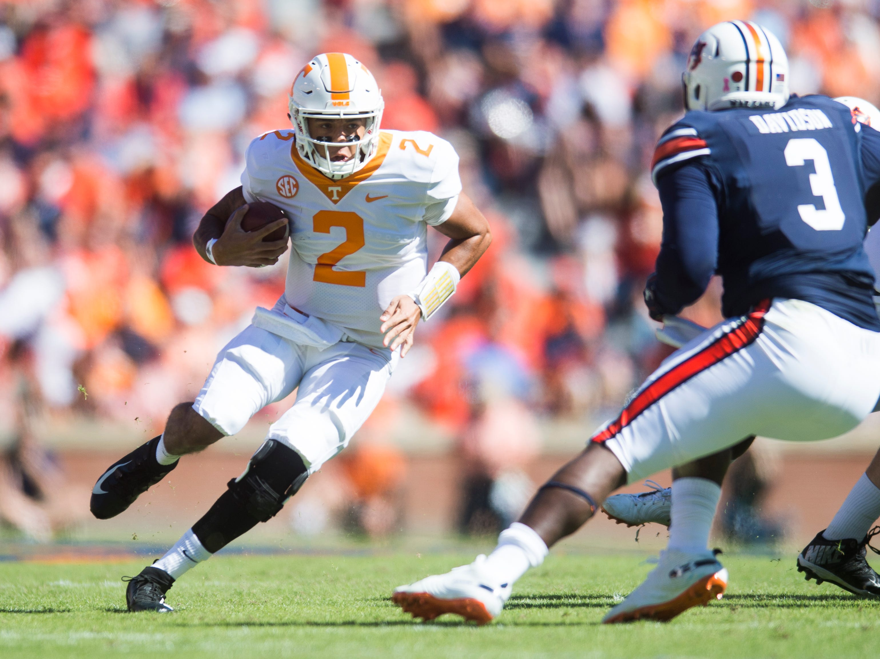 Tennessee quarterback Jarrett Guarantano (2) runs with the ball during a game between Tennessee and Auburn at Jordan-Hare Stadium in Auburn, Alabama on Saturday, October 13, 2018.