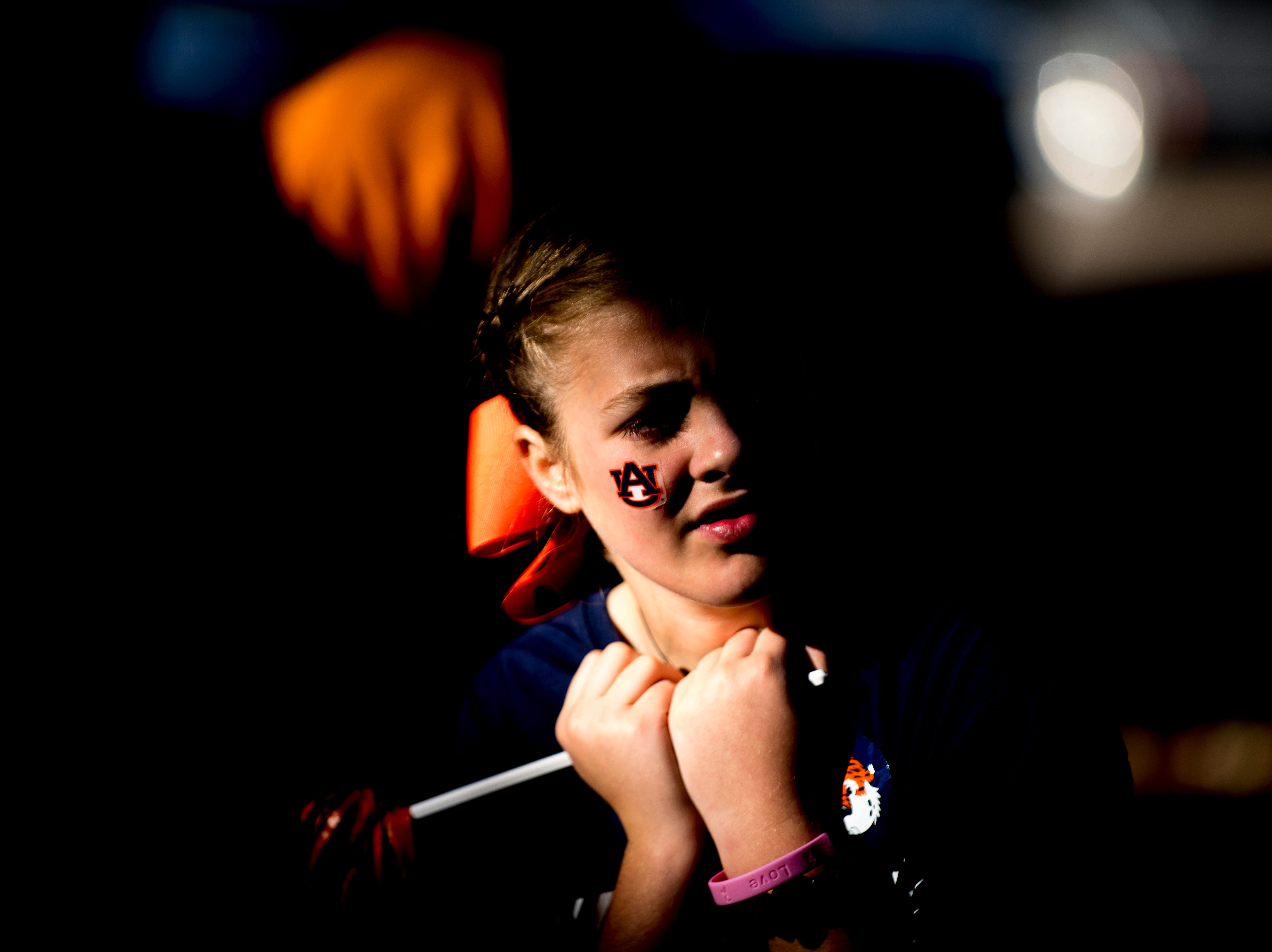 A young Auburn fan rests in the shade ahead of the Tiger Walk during a game between Tennessee and Auburn at Jordan-Hare Stadium in Auburn, Alabama on Saturday, October 13, 2018.