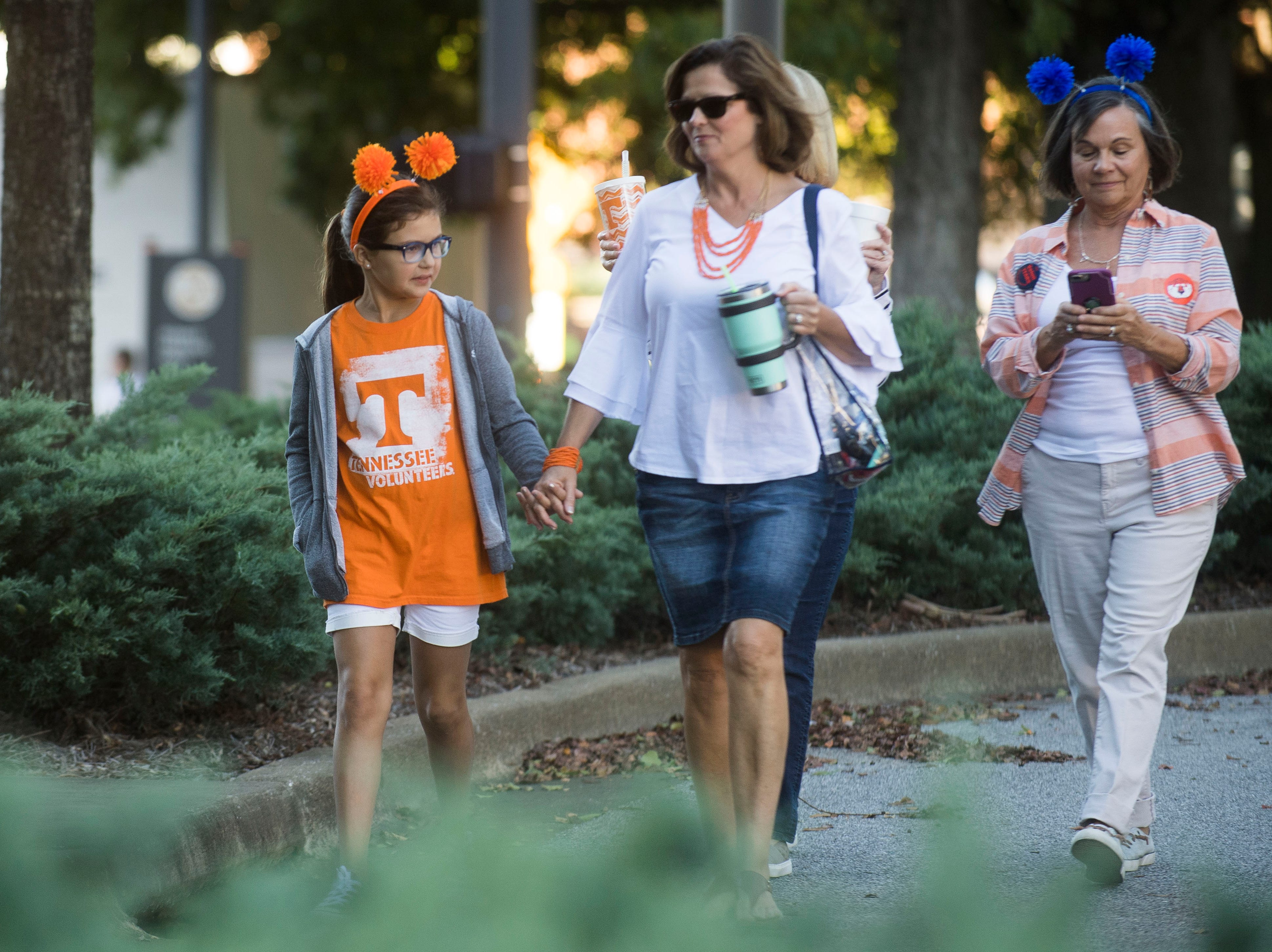 At left Gracie Gobble walks with Cindy Gobble, both of Lawrenceburg, Tenn. before a game between Tennessee and Auburn at Jordan-Hare Stadium in Auburn, Ala. Saturday, Oct. 13, 2018.