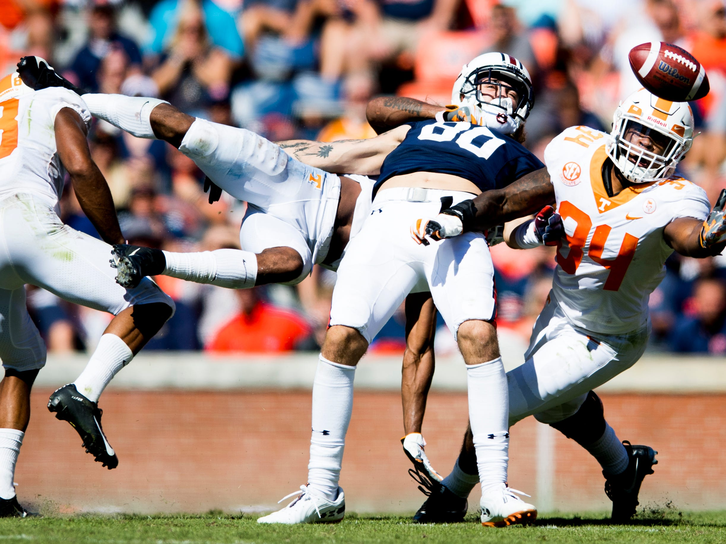 Auburn tight end Sal Cannella (80), Tennessee linebacker Darrin Kirkland Jr. (34) and Tennessee defensive back Shawn Shamburger (12), behind, go for a pass during a game between Tennessee and Auburn at Jordan-Hare Stadium in Auburn, Alabama on Saturday, October 13, 2018.