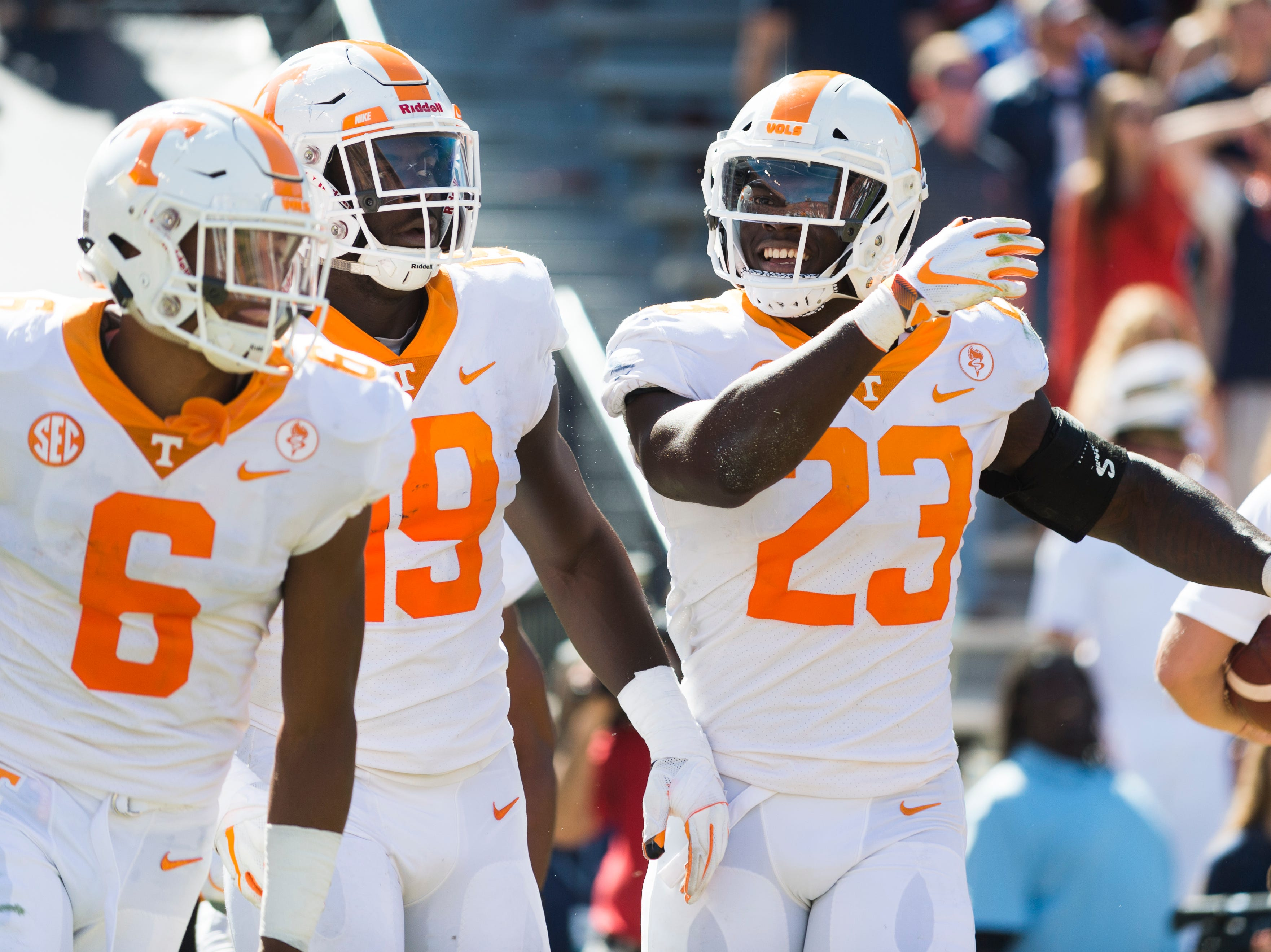 Tennessee defensive back/wide receiver Alontae Taylor (6), Tennessee linebacker Darrell Taylor (19) and Tennessee linebacker Will Ignont (23) celebrate a touchdown from a fumbled ball during a game between Tennessee and Auburn at Jordan-Hare Stadium in Auburn, Alabama on Saturday, October 13, 2018.