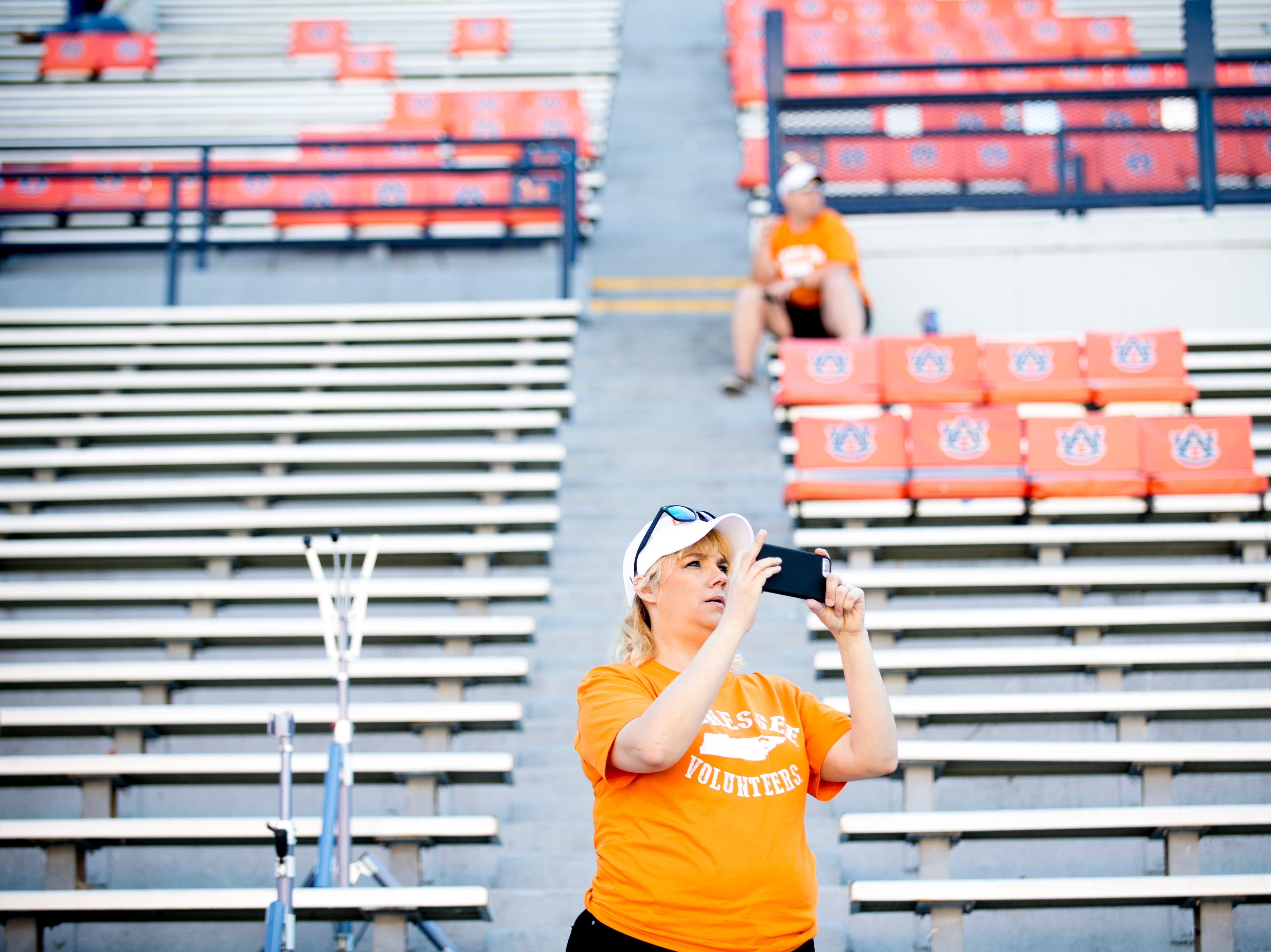 A Vol fan snaps a photo of the stadium during a game between Tennessee and Auburn at Jordan-Hare Stadium in Auburn, Alabama on Saturday, October 13, 2018.