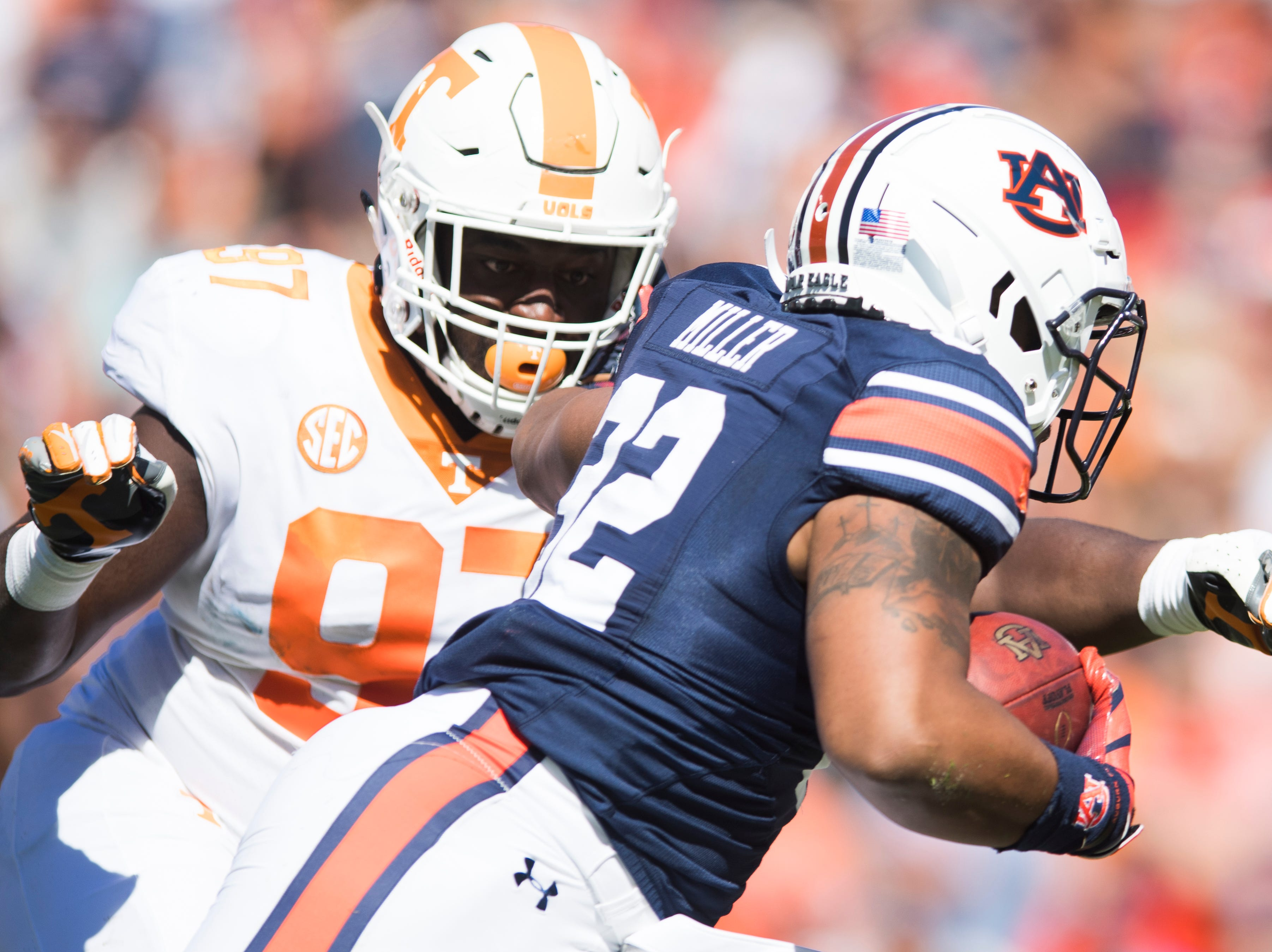 Tennessee defensive lineman Paul Bain (97) takes down Auburn defensive back John Broussard Jr. (22) during a game between Tennessee and Auburn at Jordan-Hare Stadium in Auburn, Alabama on Saturday, October 13, 2018.