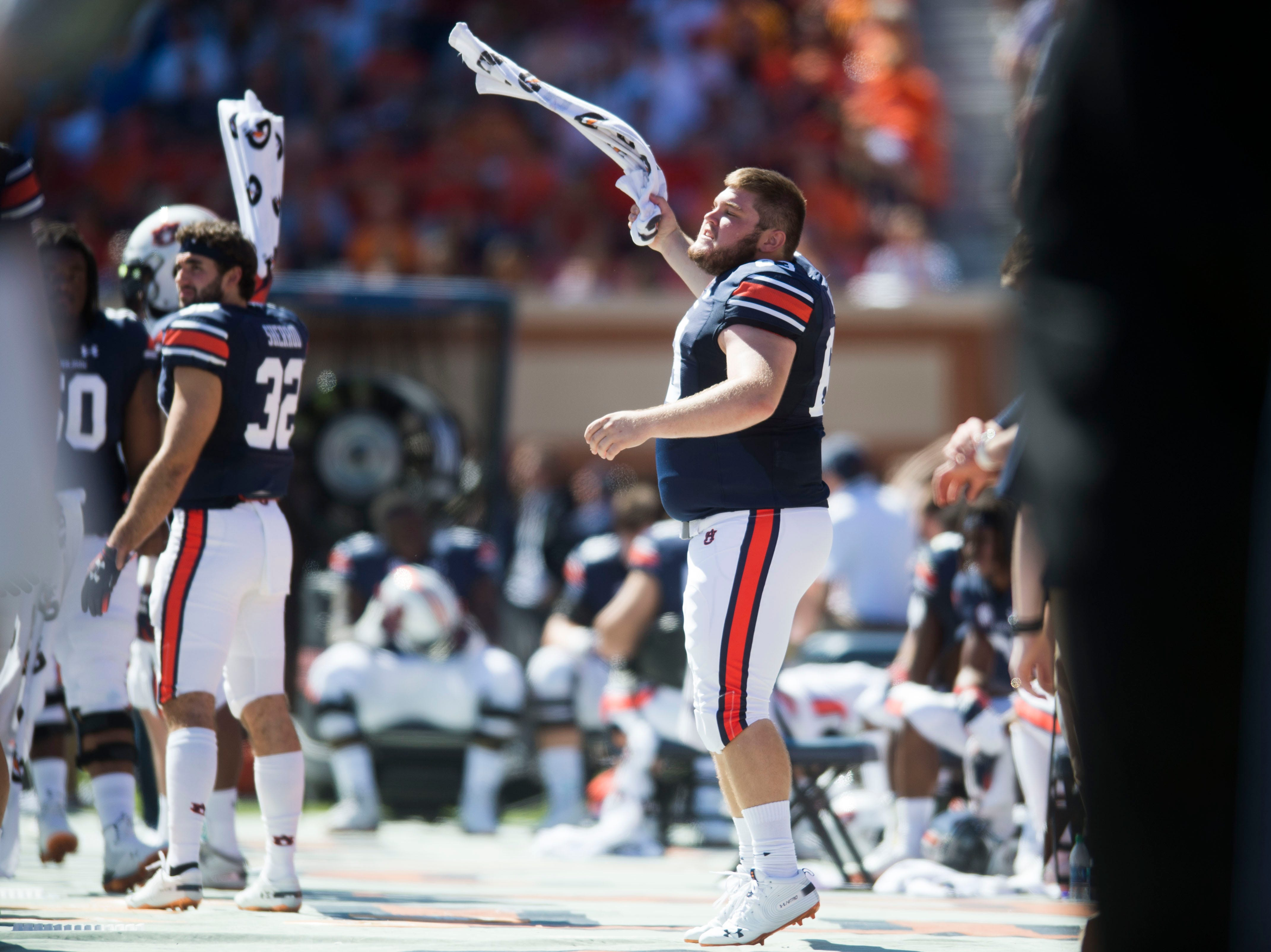 Auburn players rally the crowd on the bench during a game between Tennessee and Auburn at Jordan-Hare Stadium in Auburn, Ala. Saturday, Oct. 13, 2018.