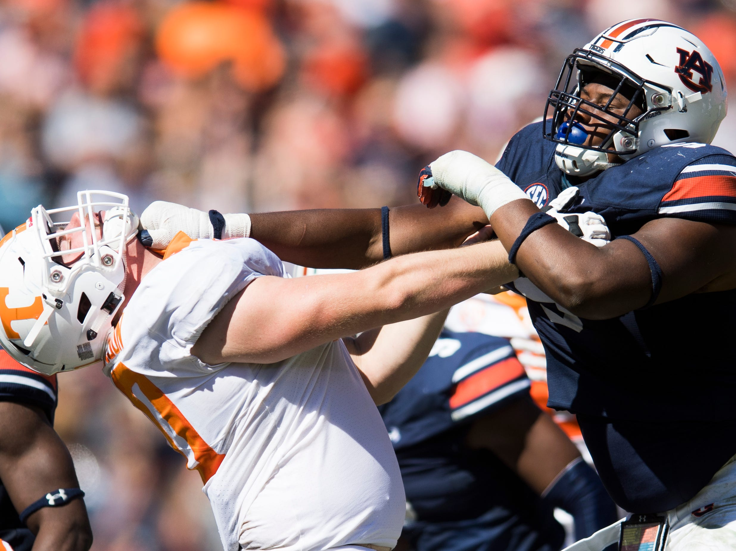 Auburn defensive lineman Derrick Brown (5) gives Tennessee offensive lineman Ryan Johnson (70) an aggressive push during a game between Tennessee and Auburn at Jordan-Hare Stadium in Auburn, Alabama on Saturday, October 13, 2018.