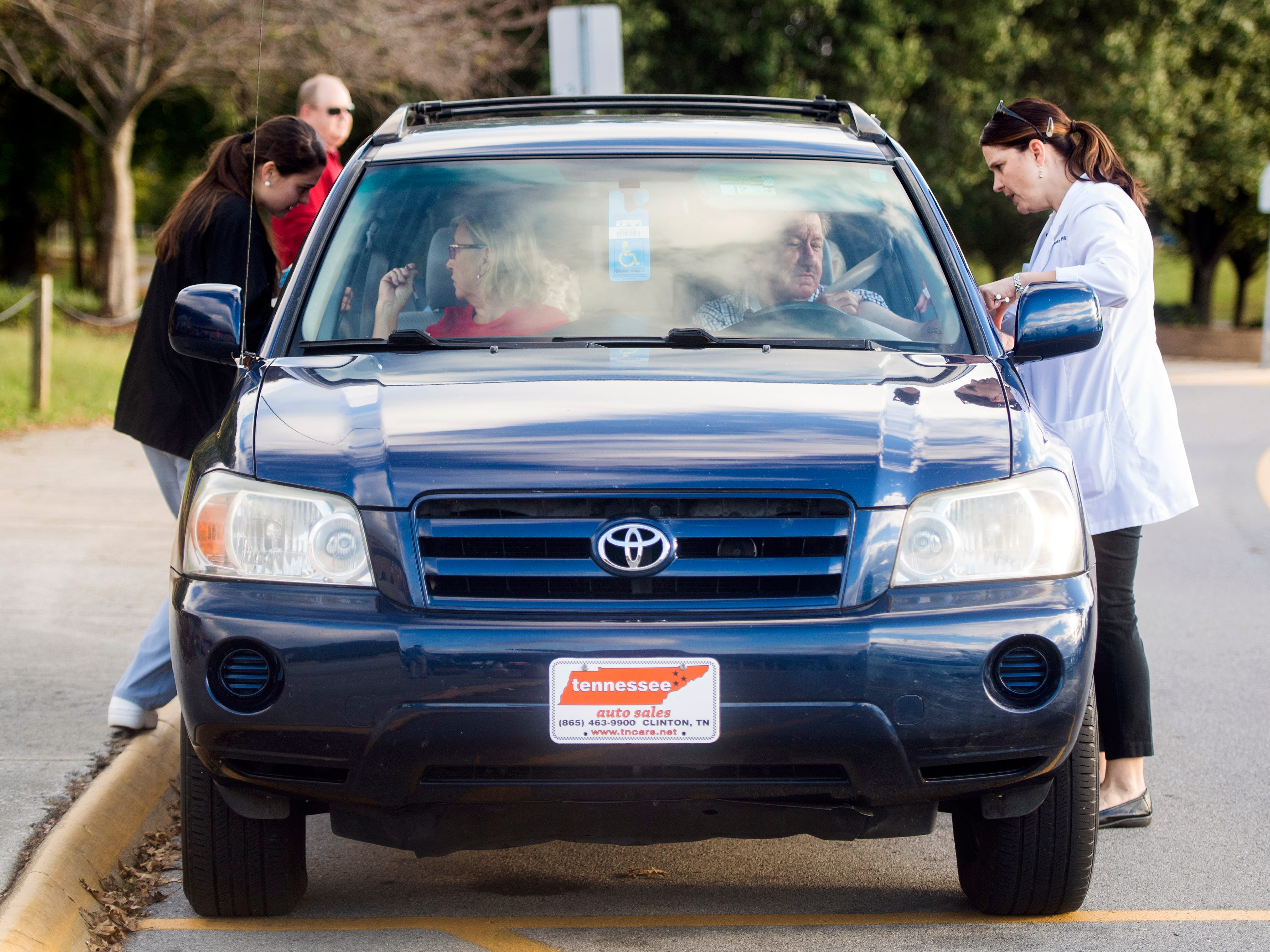 University of Tennessee nursing student Kathryn Rack, left, and UT clinical instructor Erin Morgan, right, administer flu shots in a drive thru fashion for people unable to get out of their cars at Farragut High School during Free Flu Shot Saturday on Saturday, October 12, 2018.